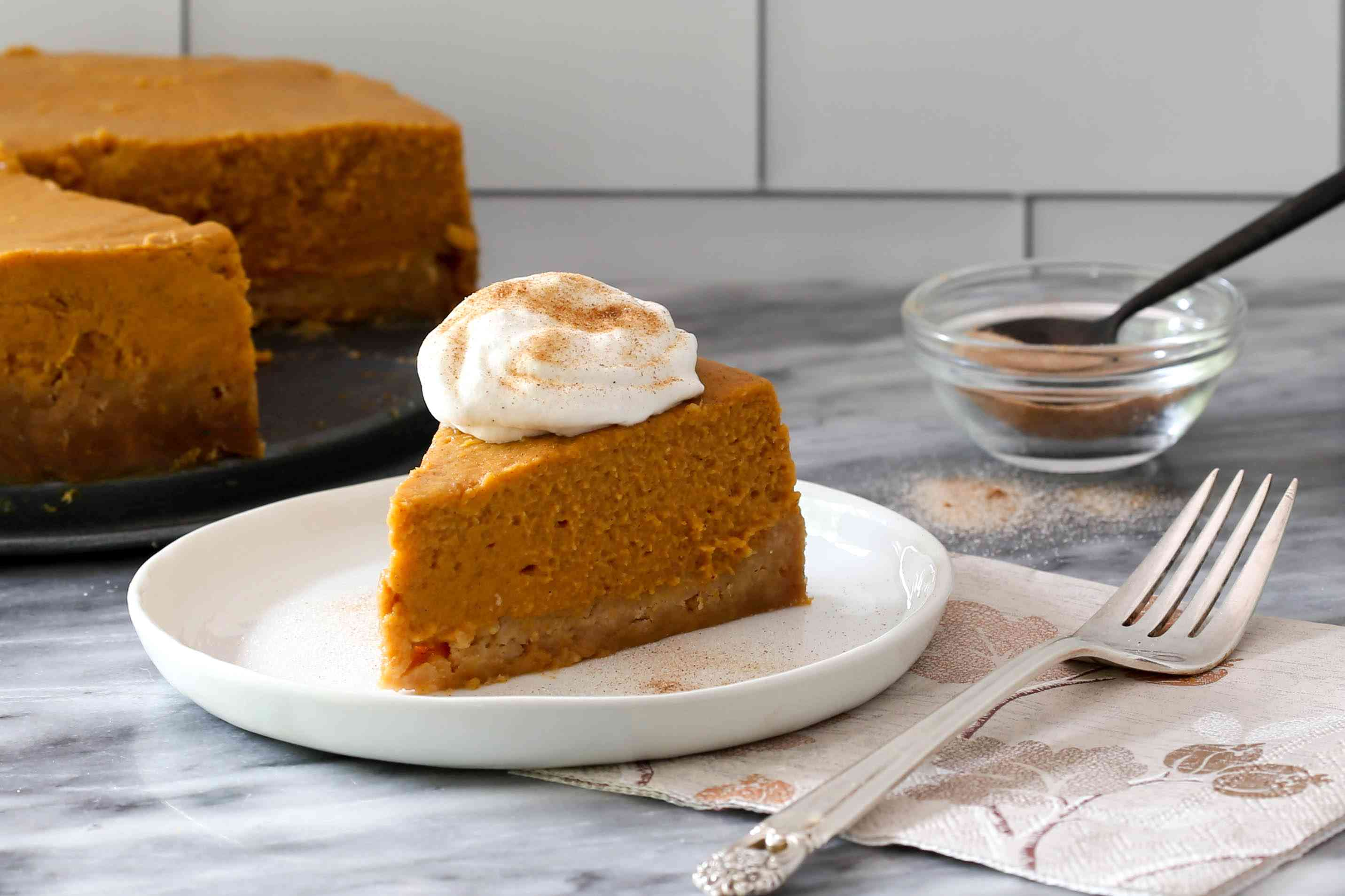 slice of pumpkin pie from the instant pot with whipped cream