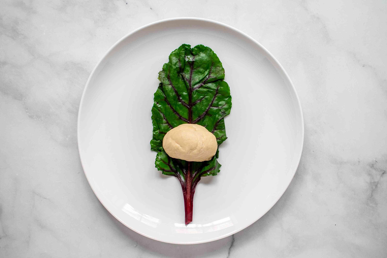 place dough on a beet leaf