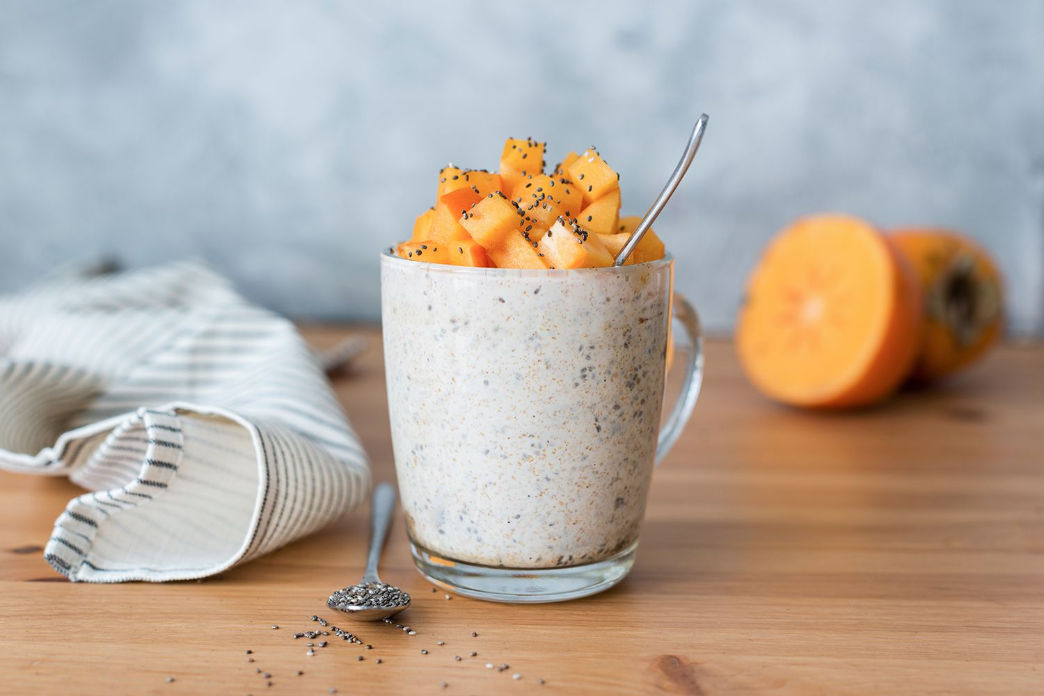 Chia seed pudding with persimmon in glass