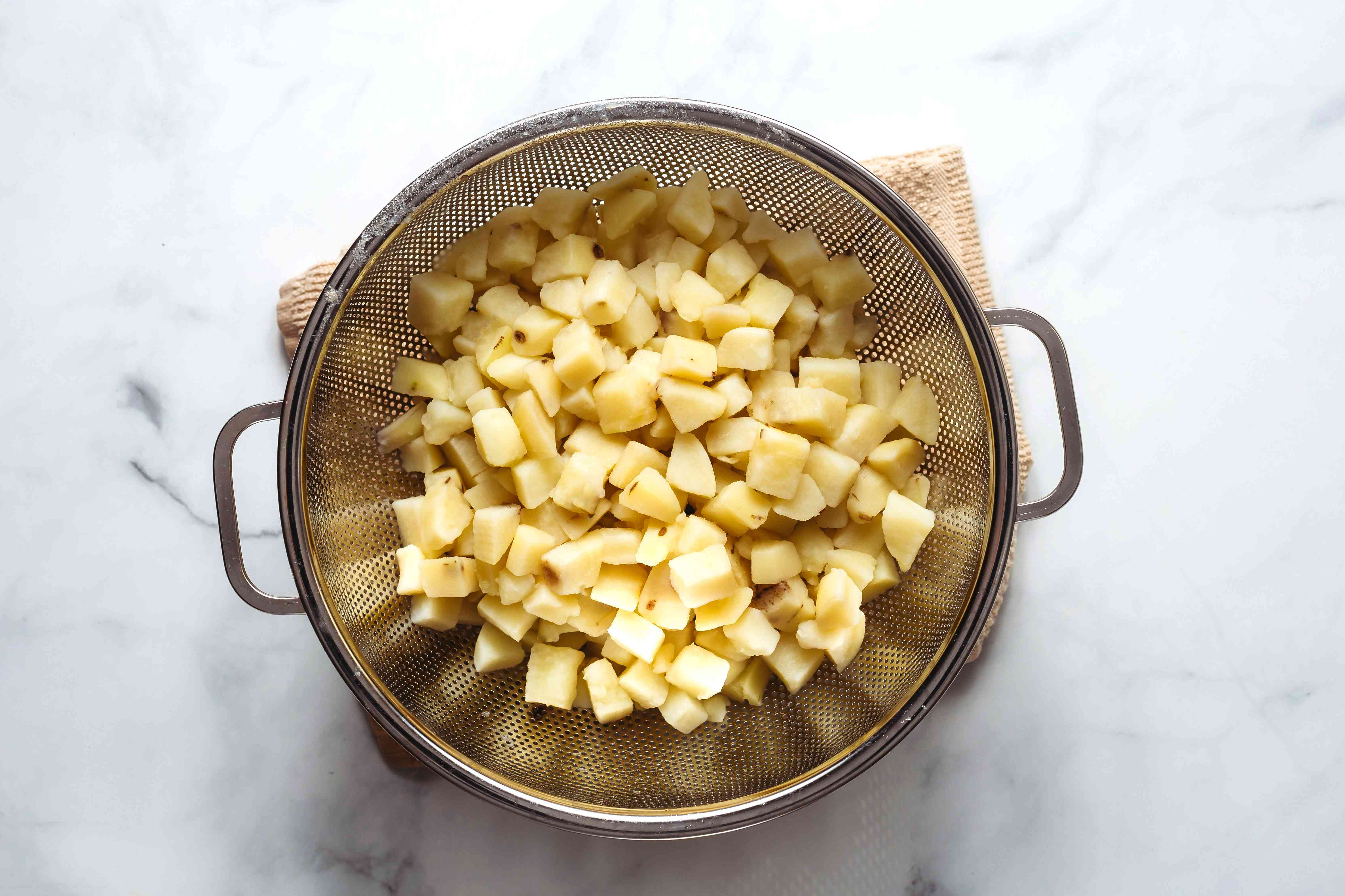 drained potatoes in a colander