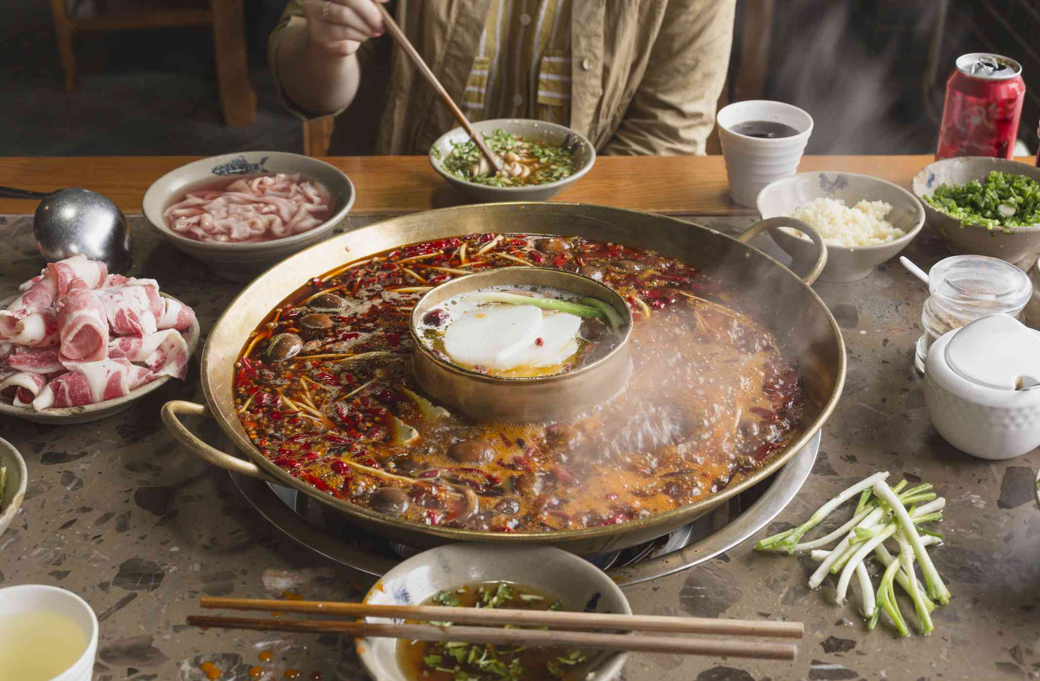 Person eating hot pot in Sichuan, Chin