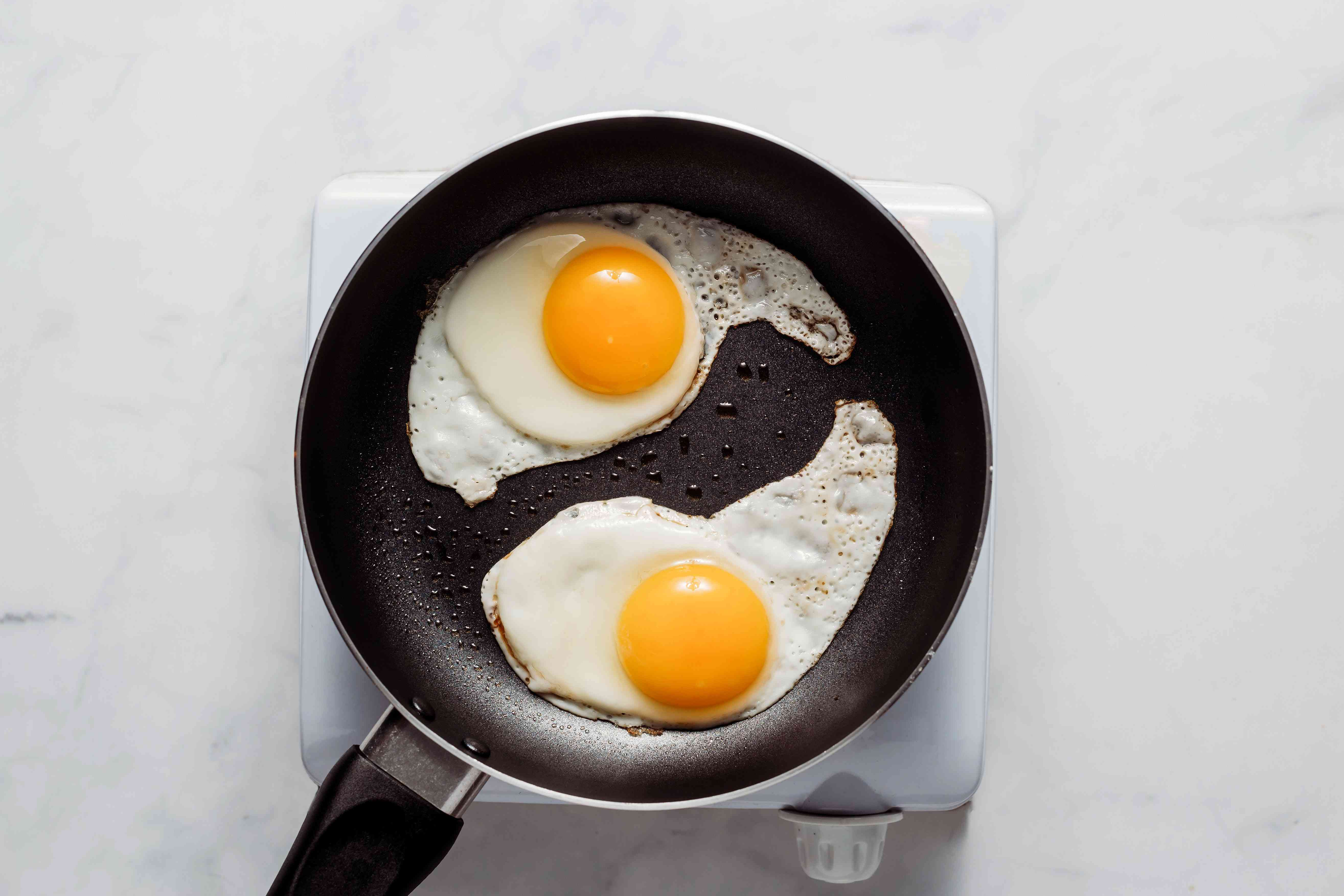 eggs frying in a skillet