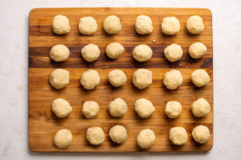 Roll masarepa dough into golfball-size balls on a cutting board