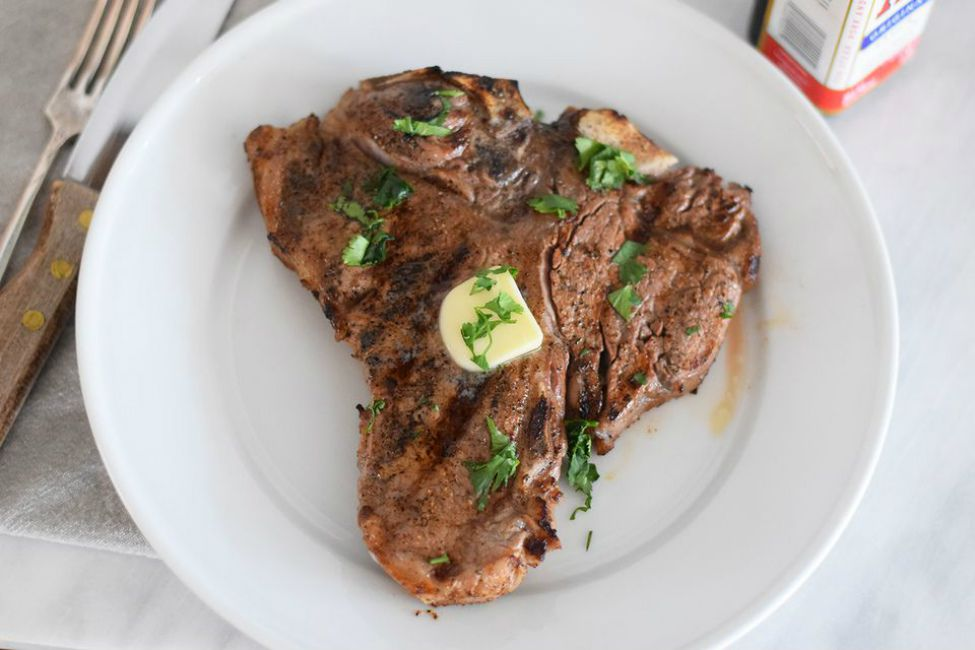 Perfect restaurant steak with a pad of butter and snipped parsley