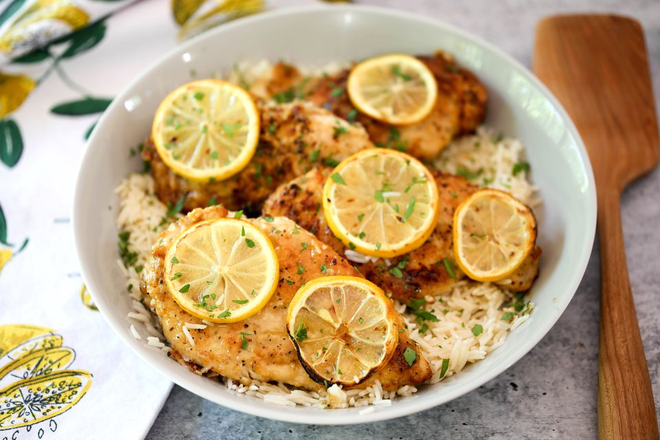 Lemon pepper chicken on a bed or rice.
