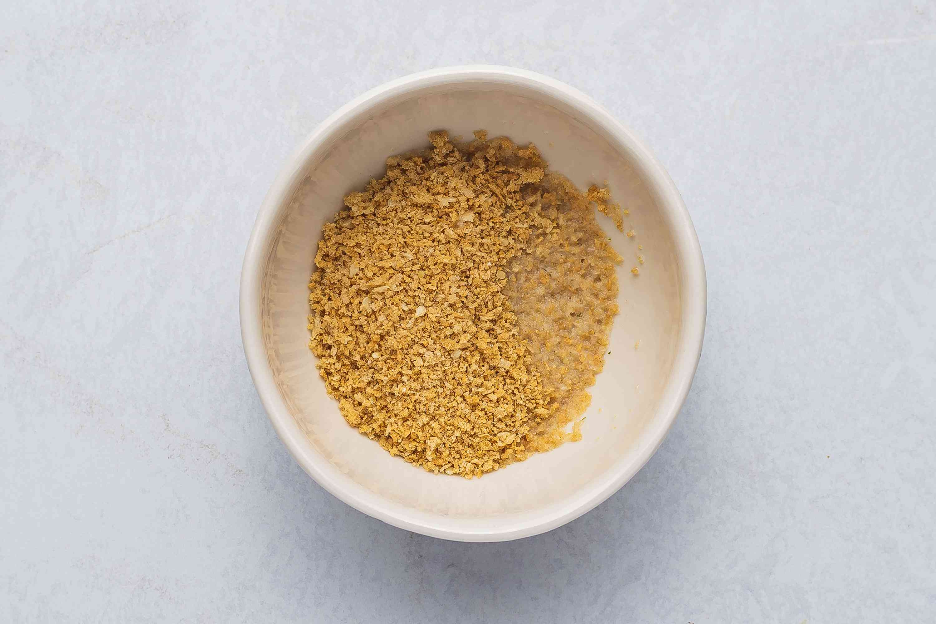 Milk and panko in a bowl