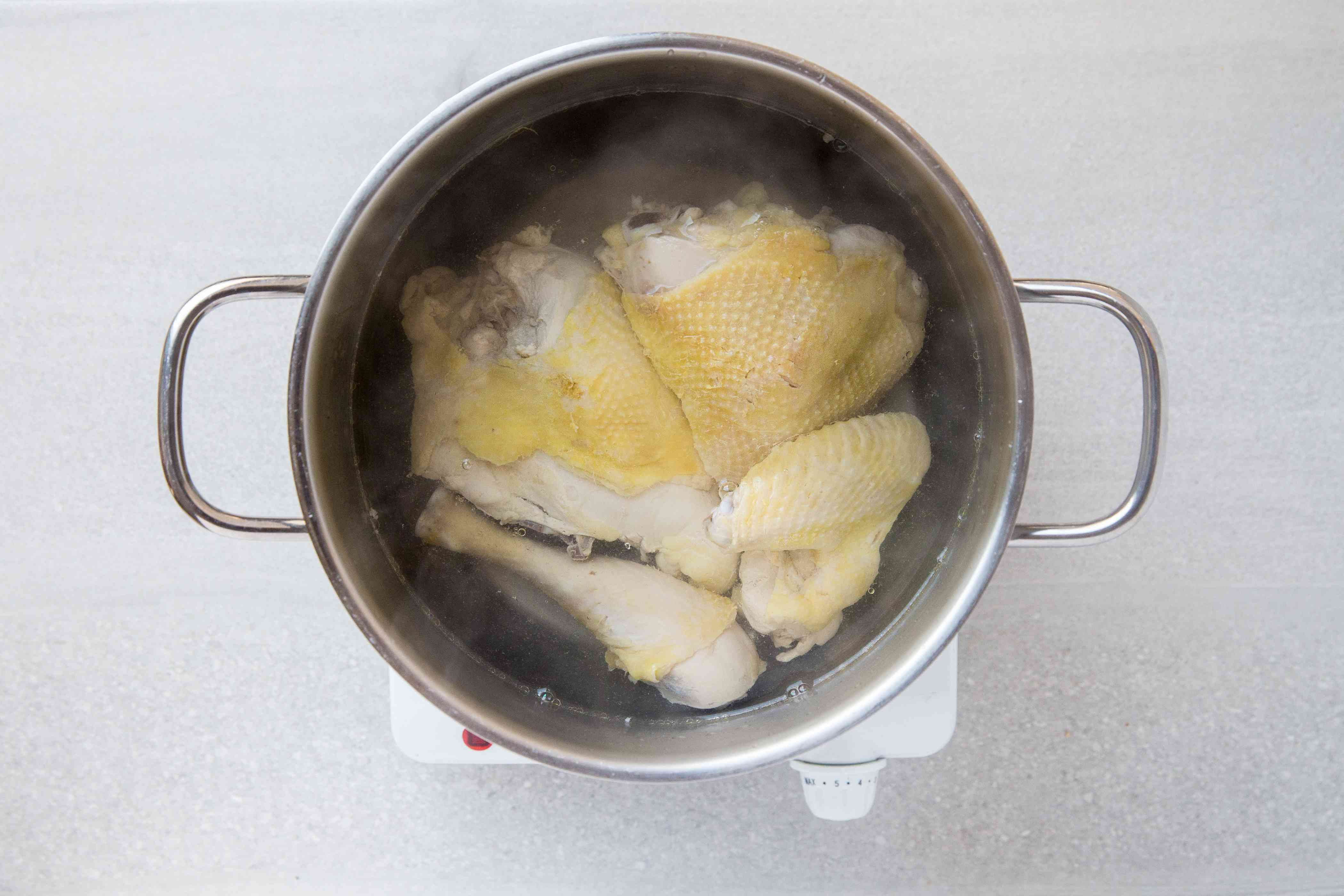 Chicken in a pot of water