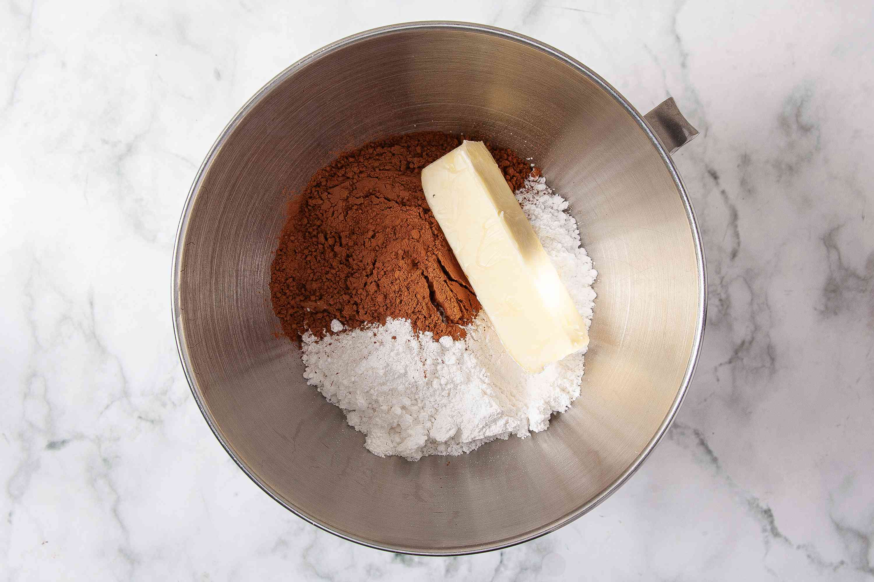 German chocolate cupcake frosting ingredients in a mixing bowl