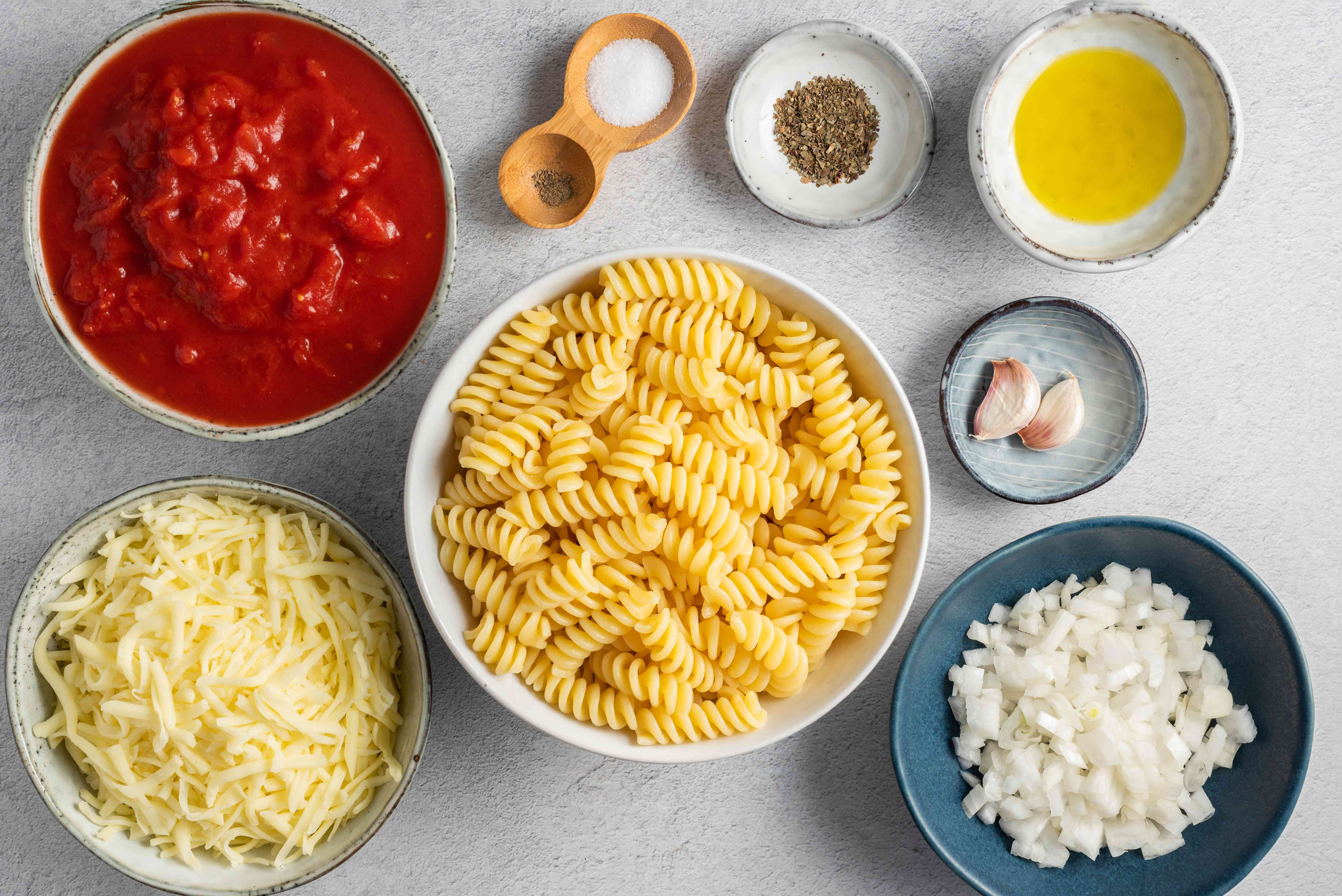 Ingredients for rotini bake with tomatoes and cheese