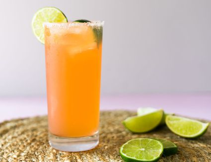 Paloma cocktail with lime garnish