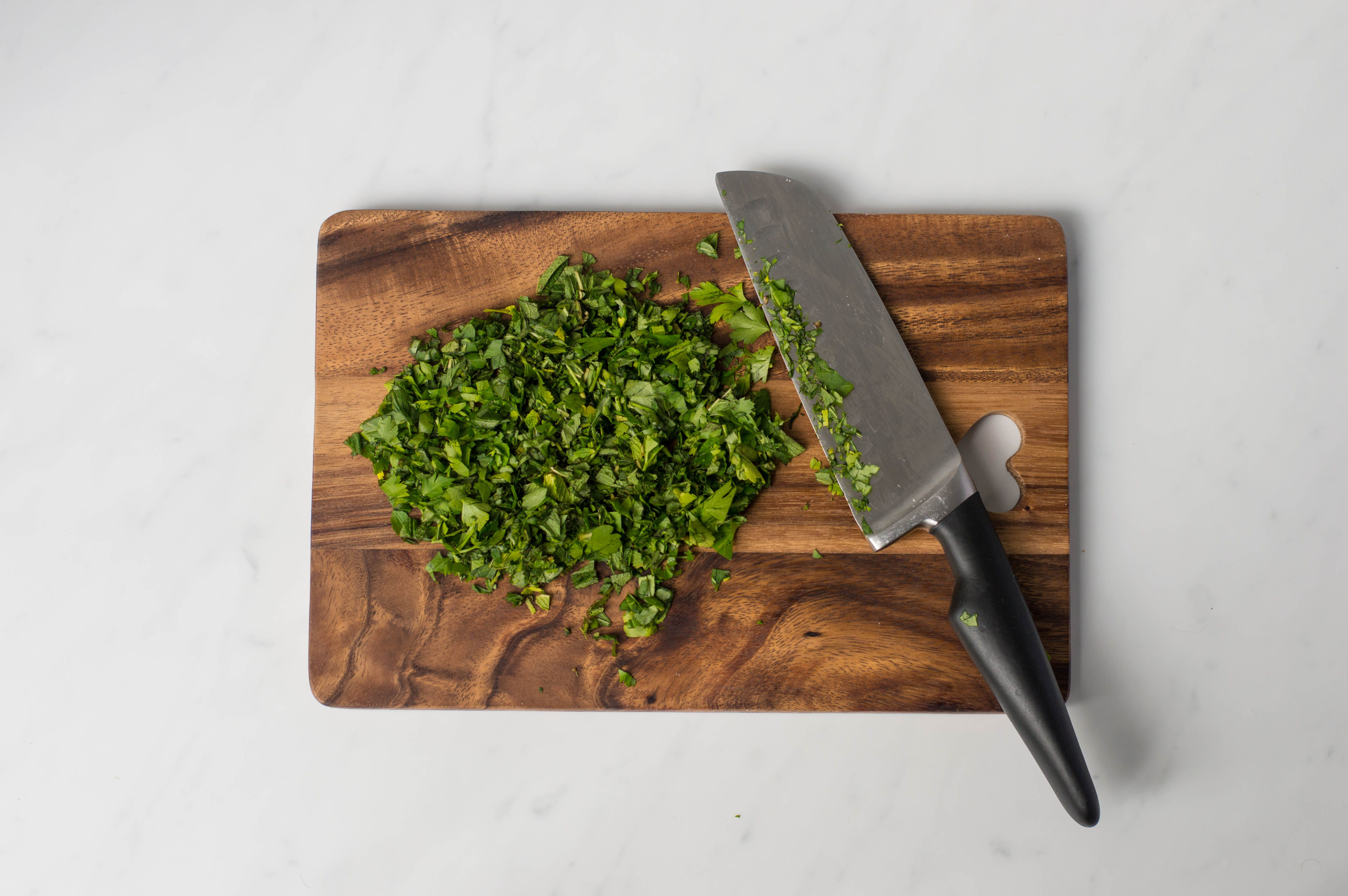 Finely chopped parsley on a cutting board