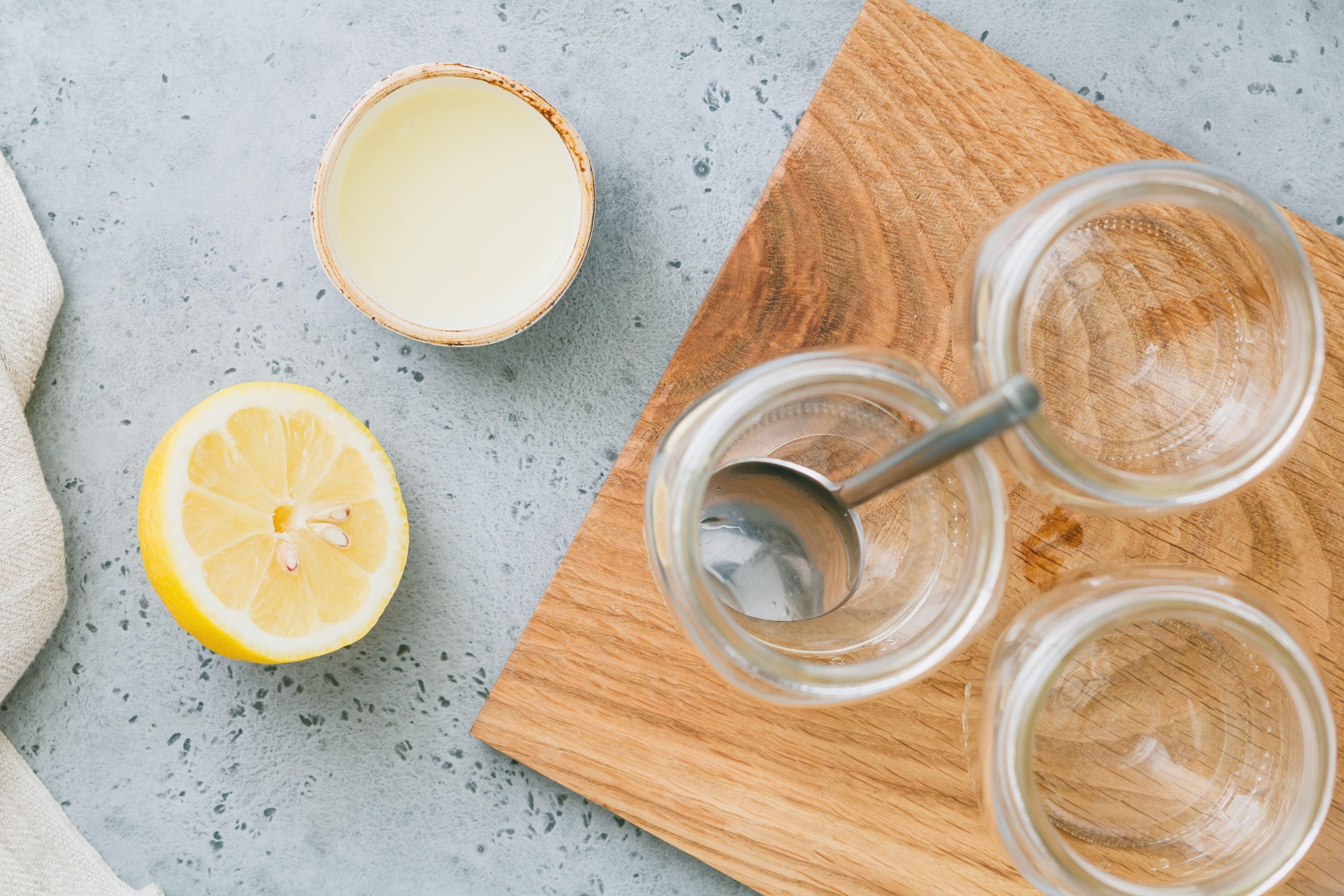 A lemon sitting next to the empty jars