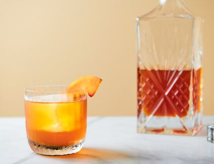 A glass of homemade peach liqueur