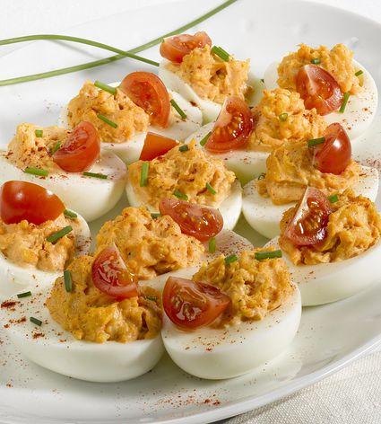 Delicious deviled eggs with tuna and tomato