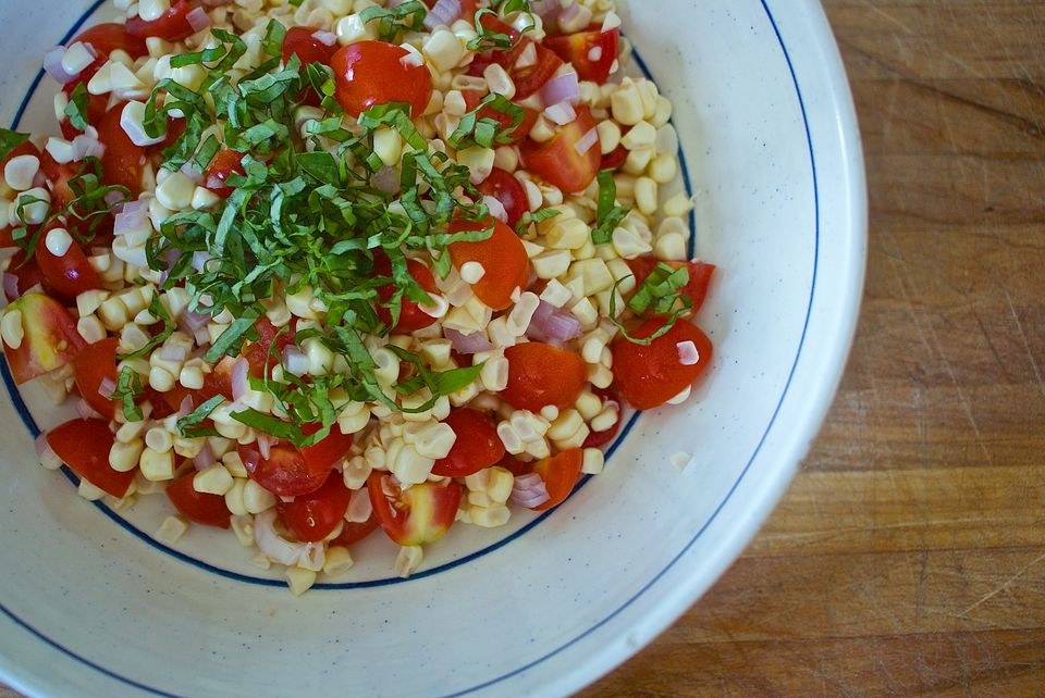 A corn tomato and basil salad