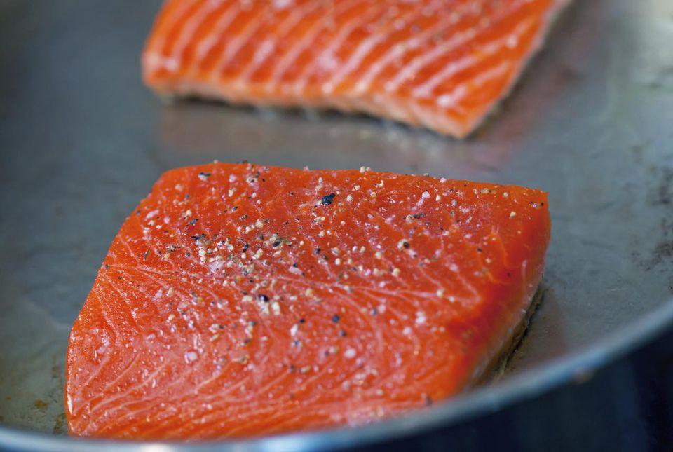 Salmon searing in a pan