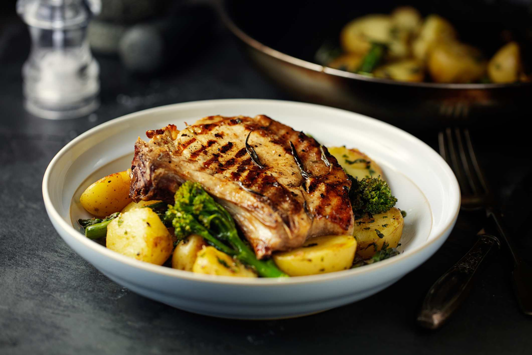 grilled pork chop with garlic sauté potatoes