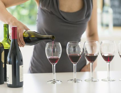Pouring wine into wine glasses