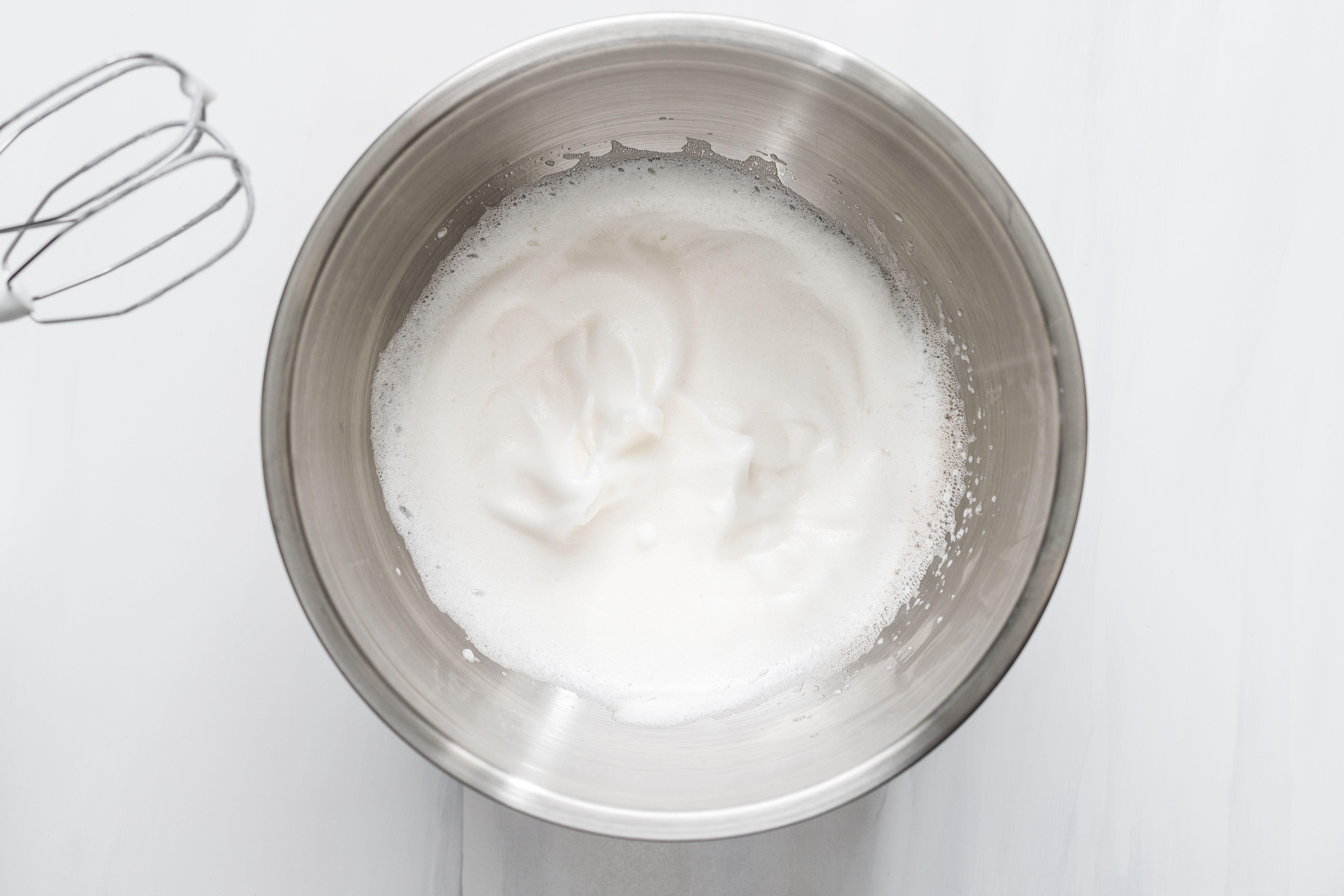 Beaten egg whites in metal bowl