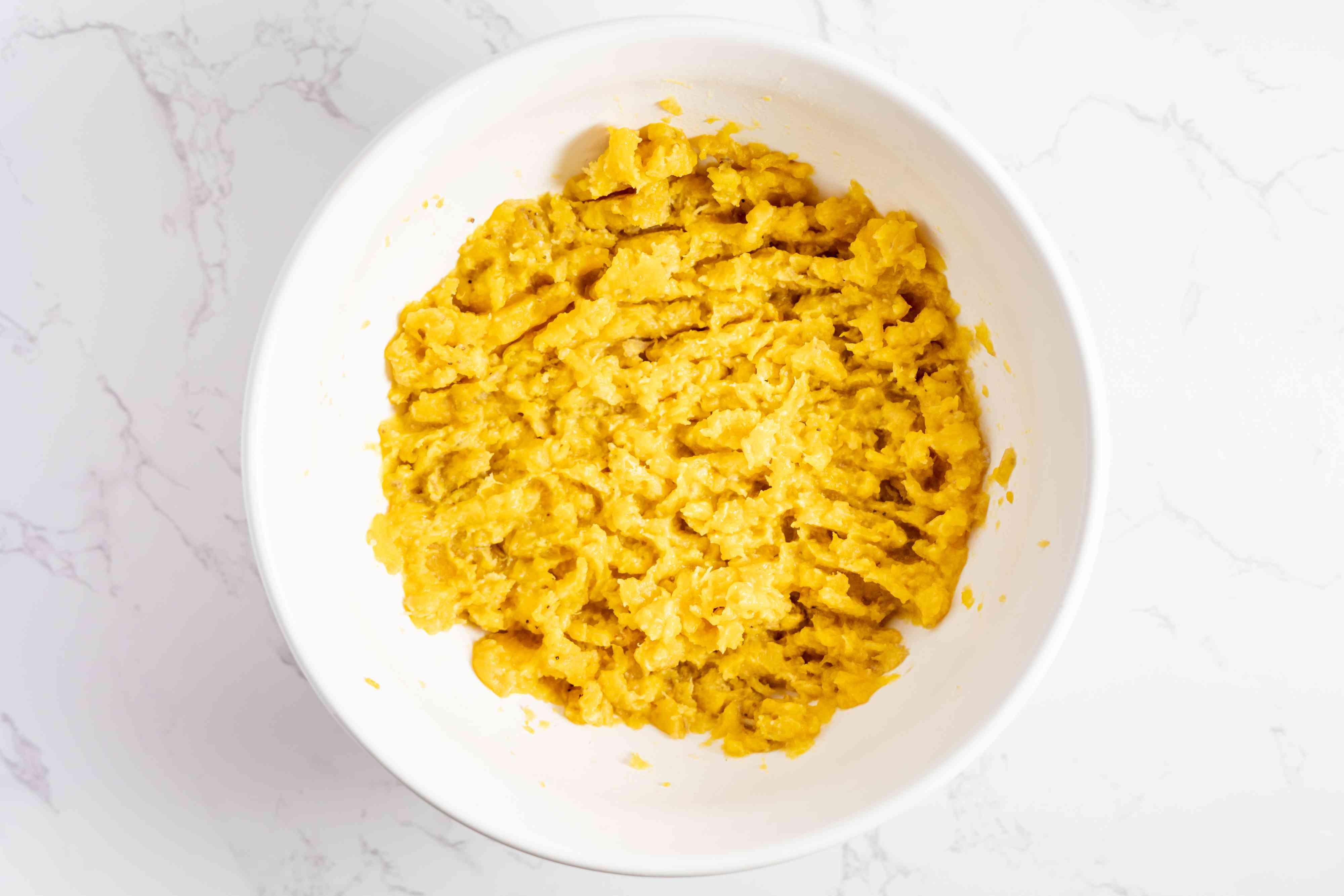 mash the plantains using a potato masher