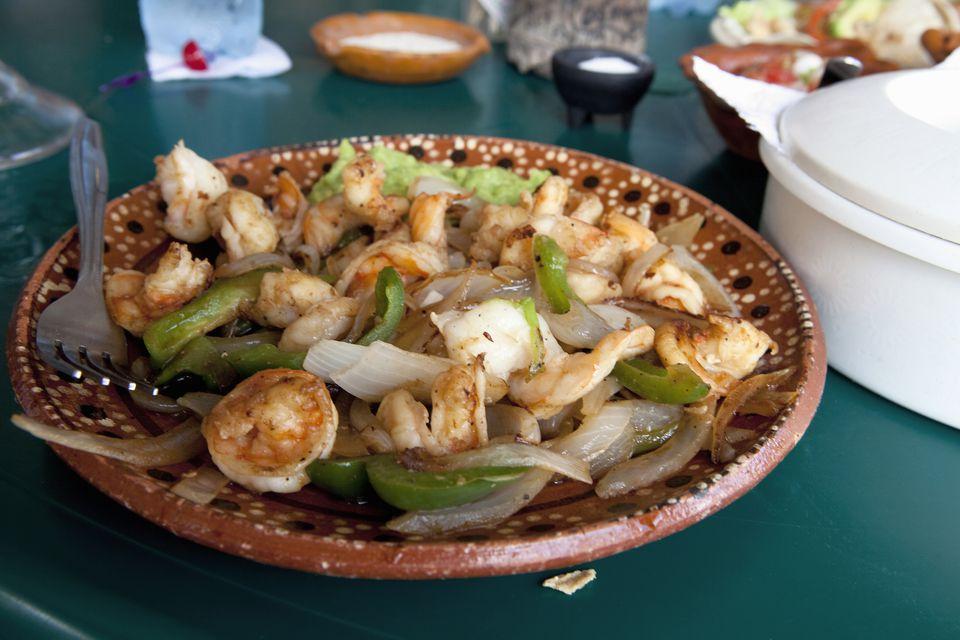 Shrimp fajita served on Mexican pottery plate