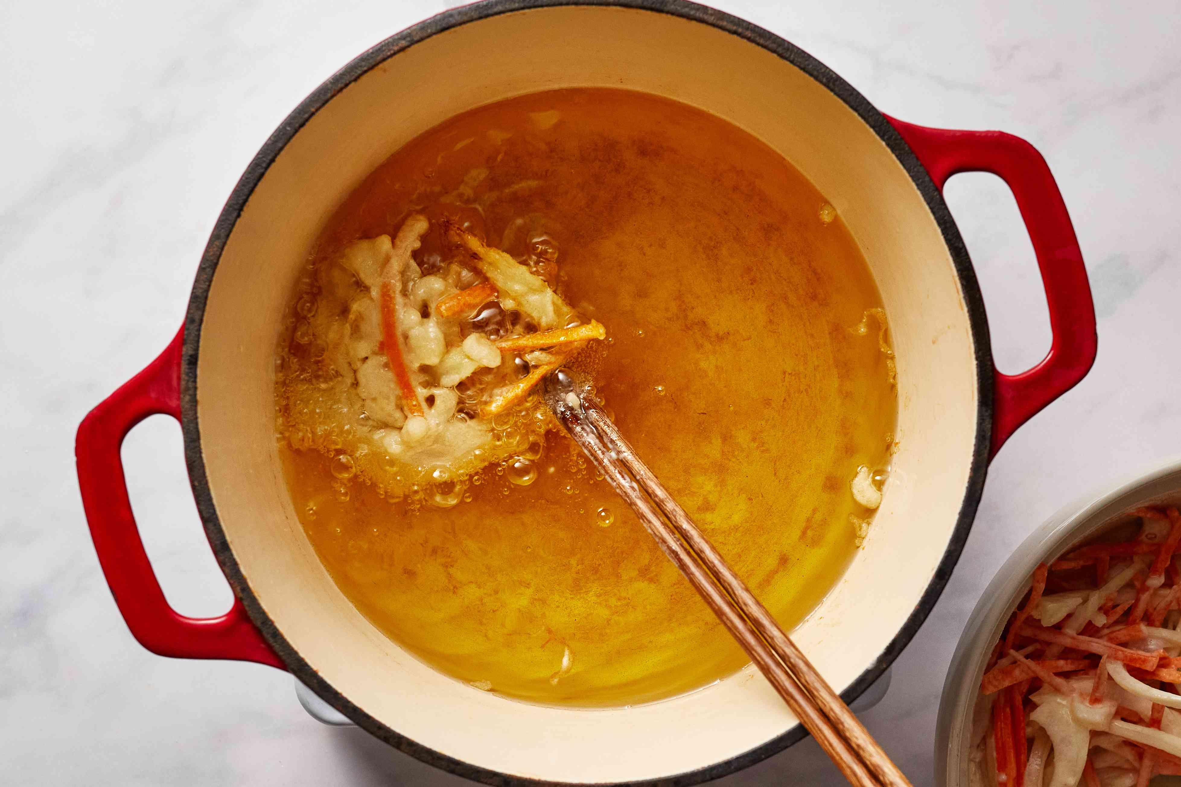 Kakiage Tempura frying in a pot with oil