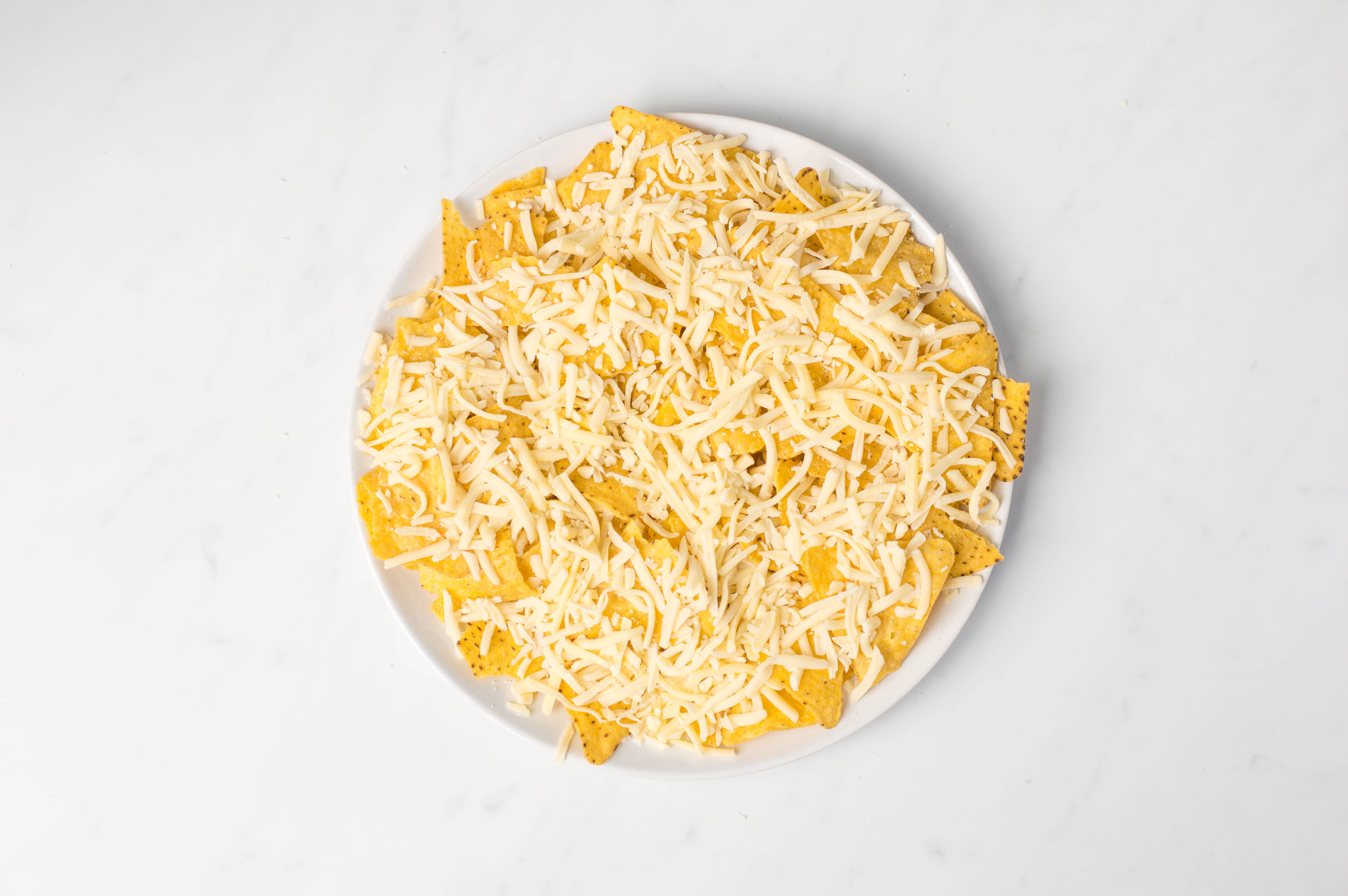 Sprinkle cheese over chips