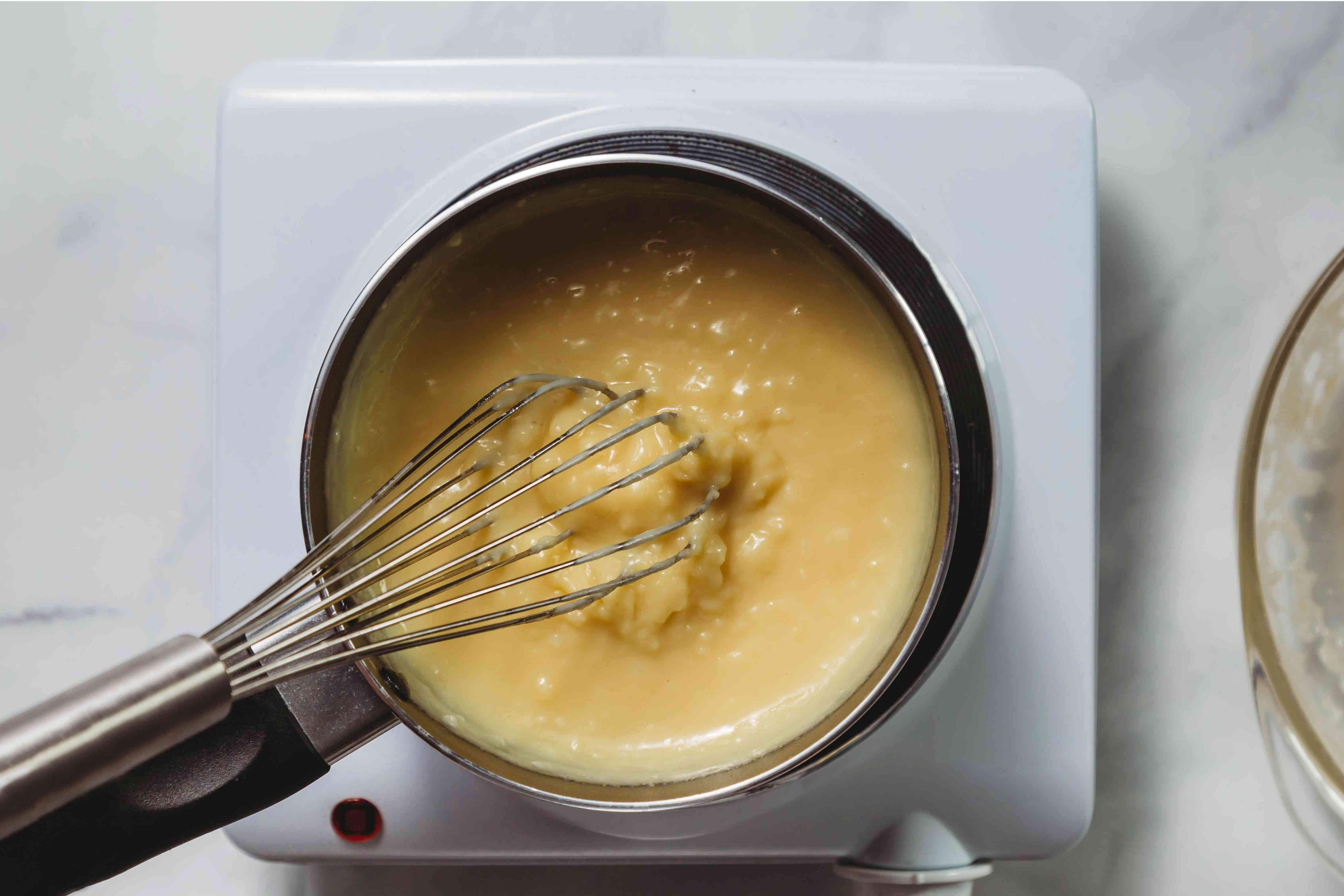 egg and milk mixture in pot with whisk