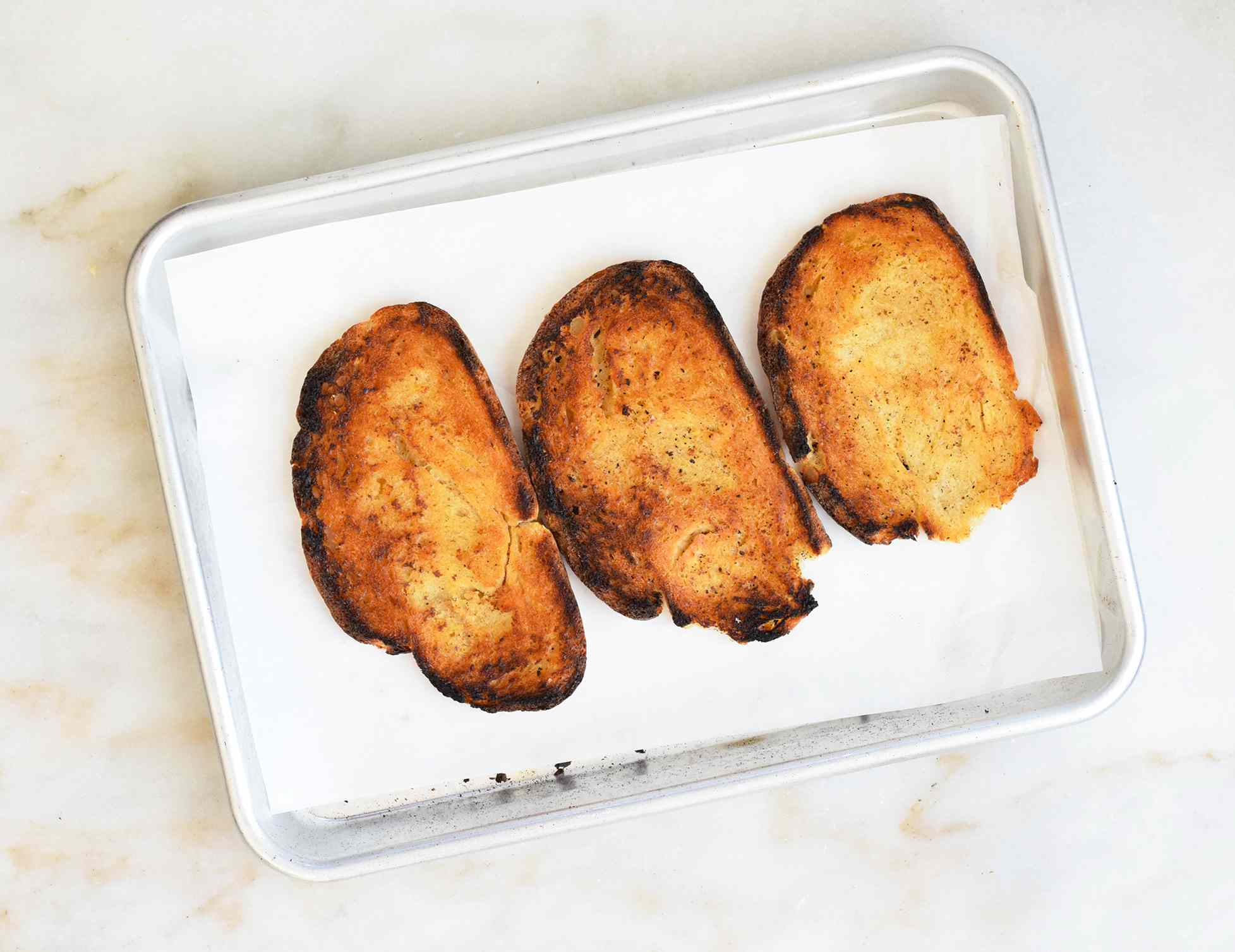 toasted bread on a sheet pan