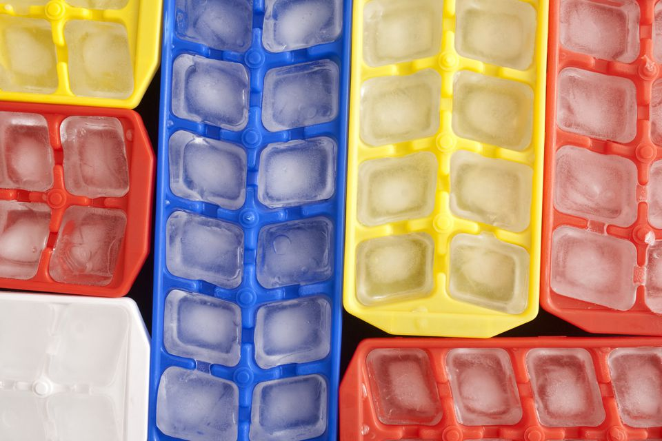 Top view of ice cubes in plastic containers