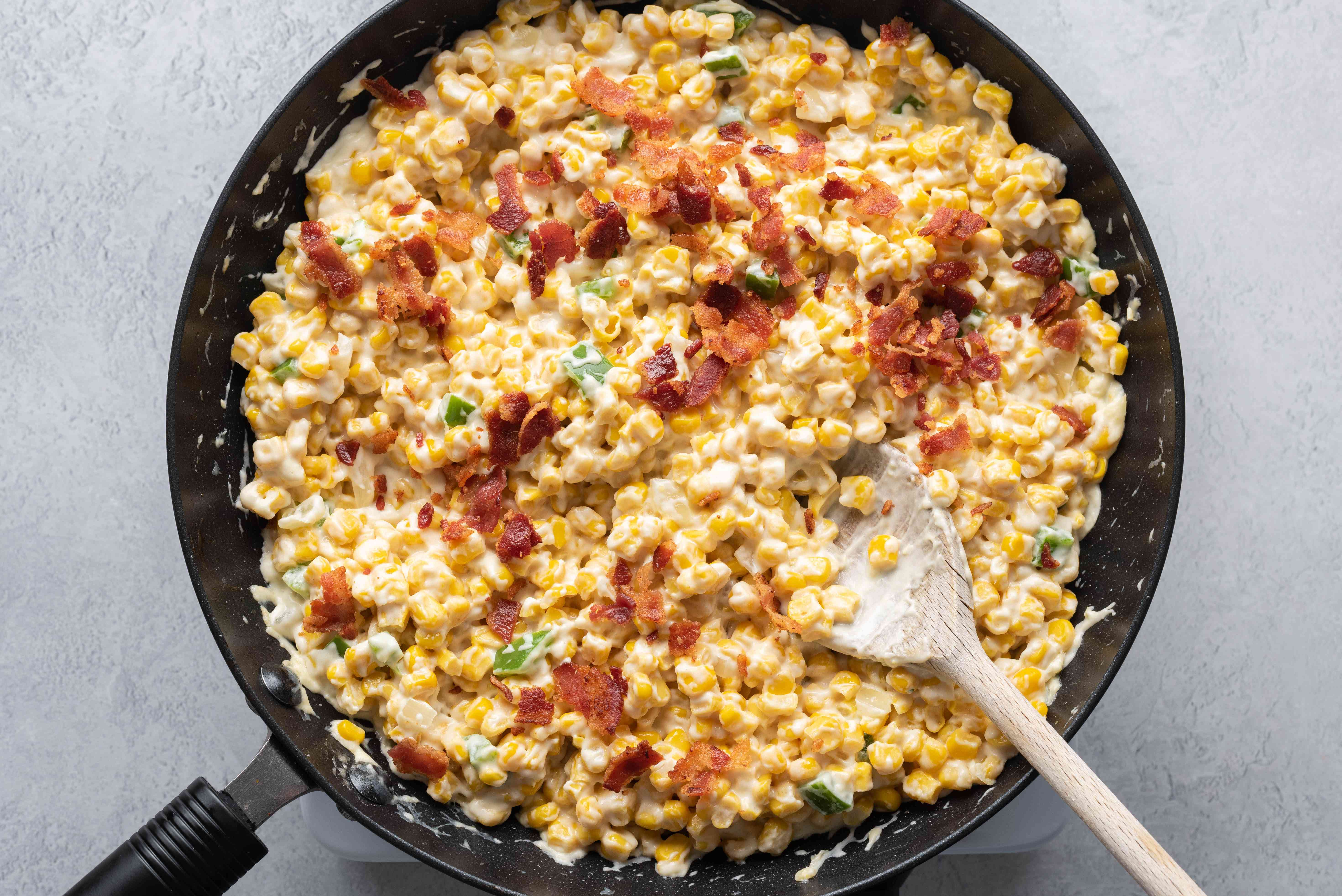 Corn With Bacon and Sour Cream cooking in a skillet