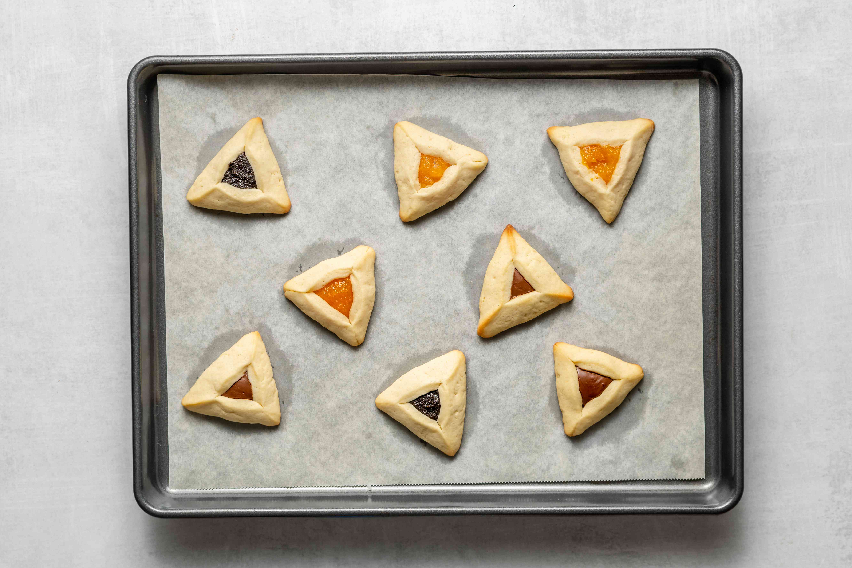 Hamantashcen cookies baked on a baking sheet