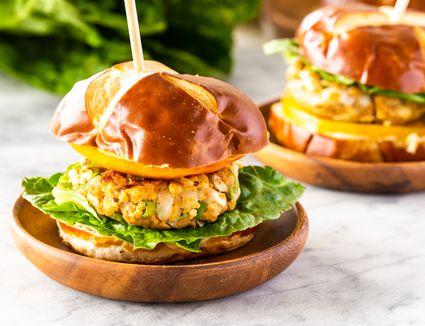 Vegan tofu veggie burgers on a wooden plate