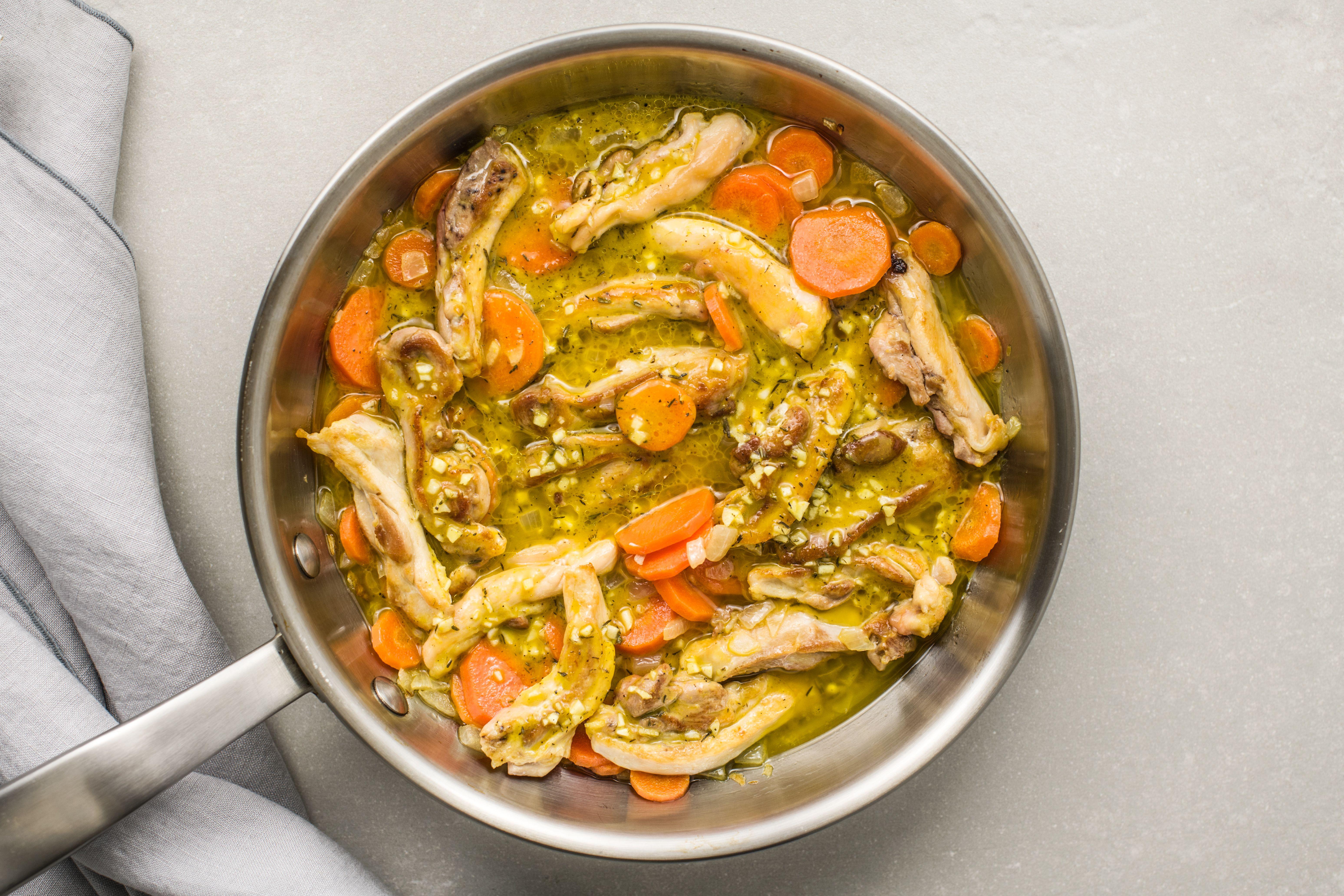 Turn chicken in skillet