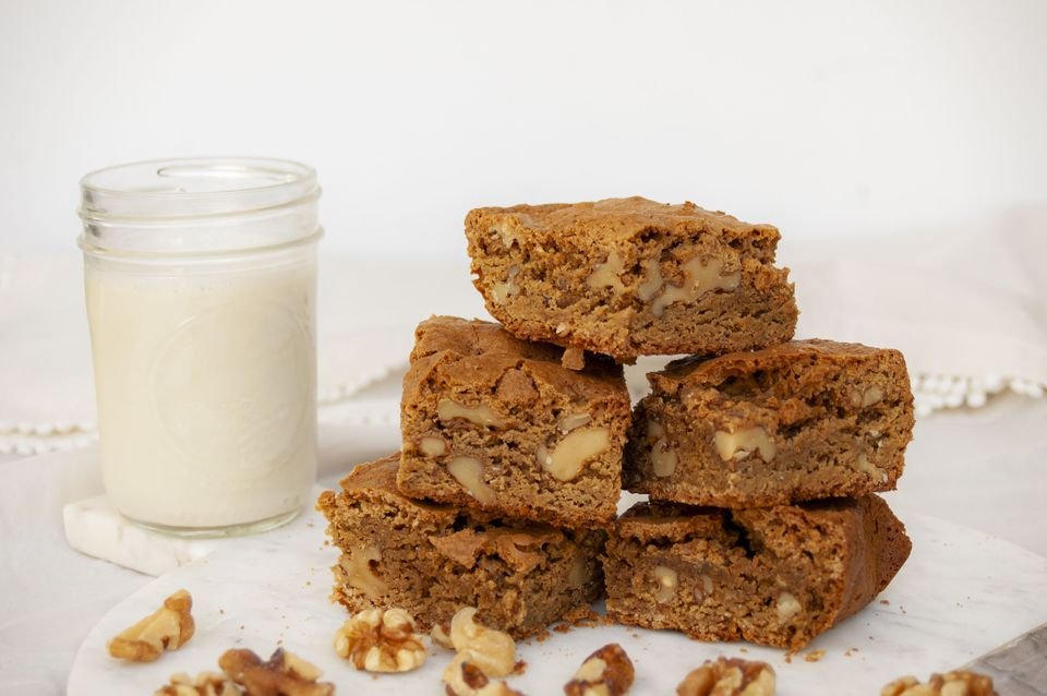 brown butter blondies with walnuts and a glass of milk