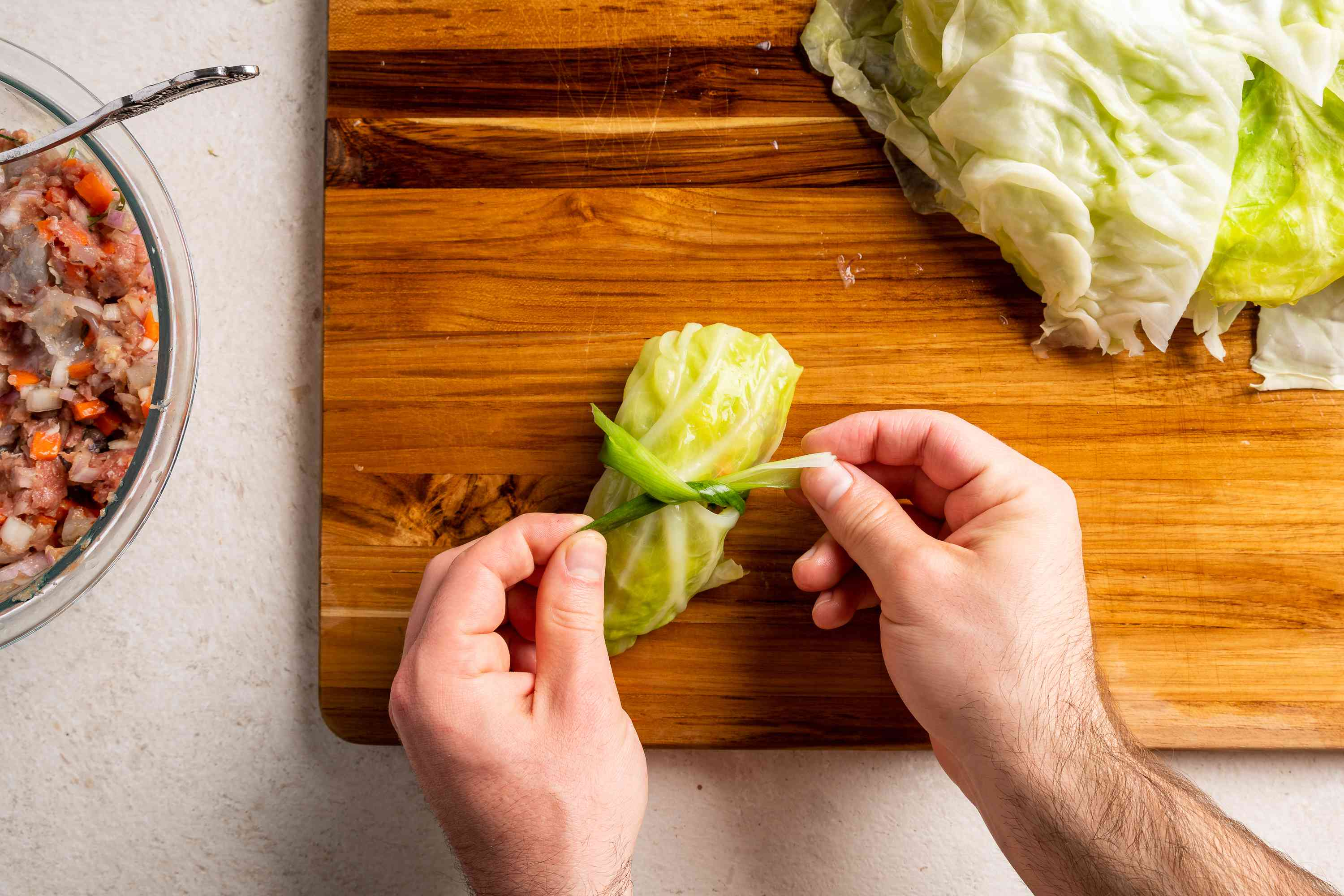 Take a scallion and use it to tie the cabbage roll
