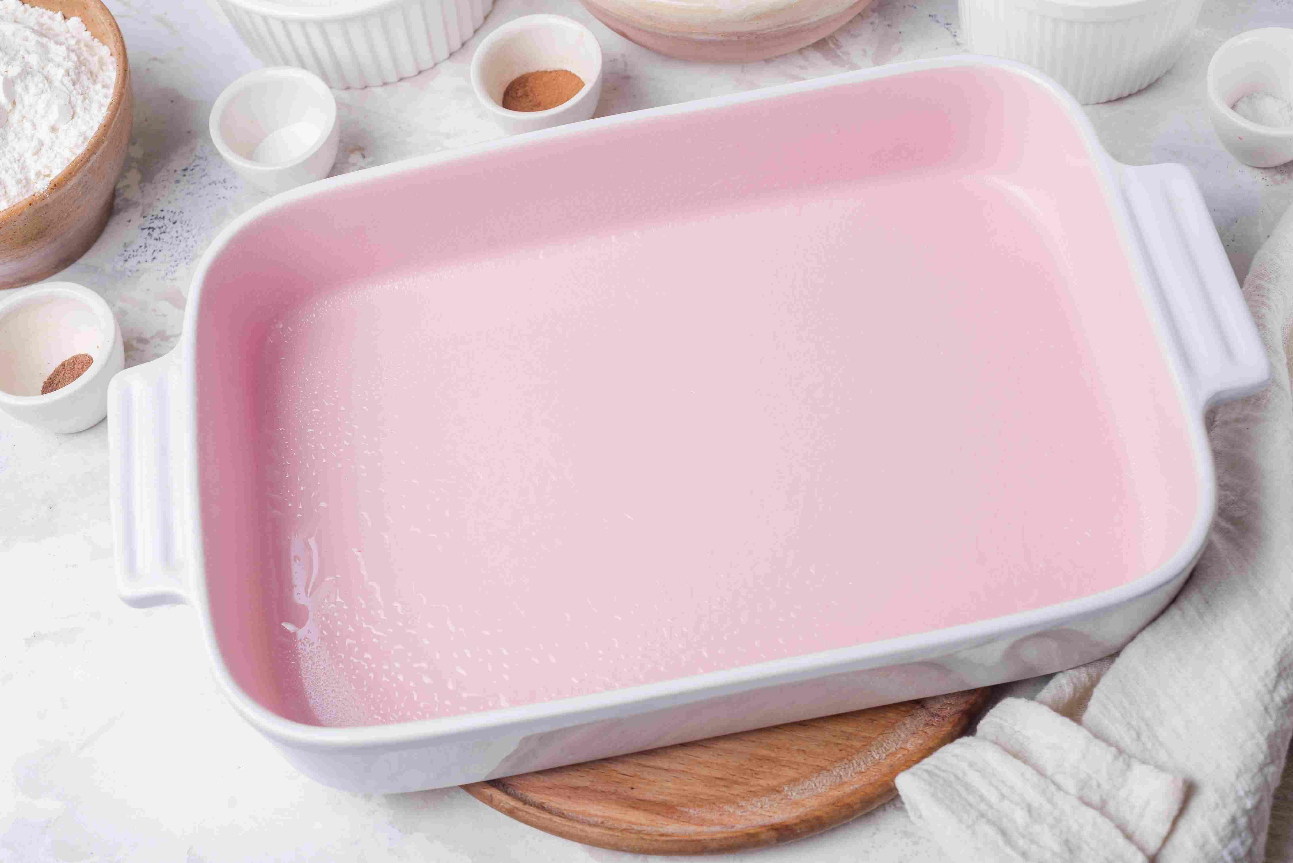 Grease the baking pan
