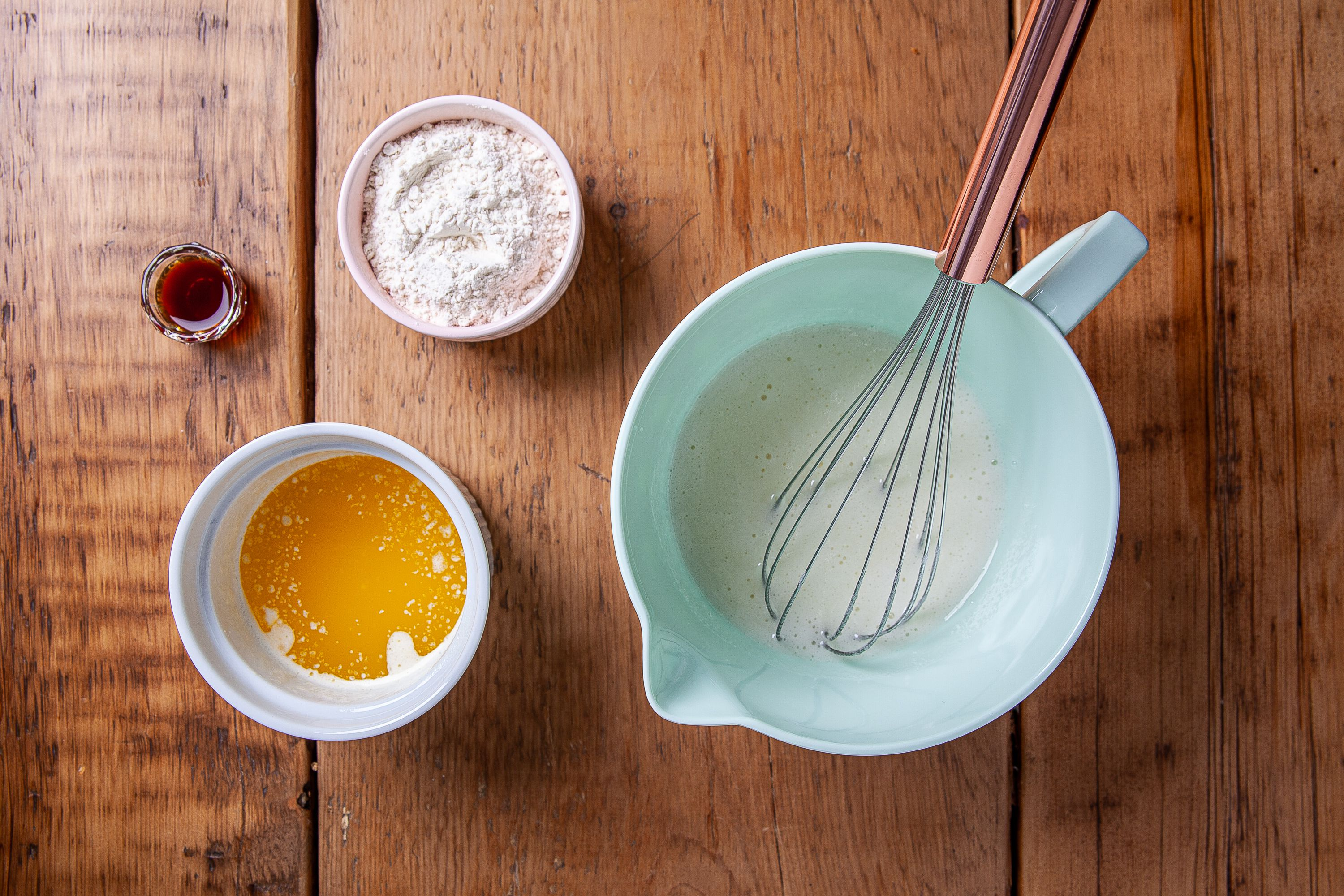 Add egg flower and vanilla into the whisked ingredients