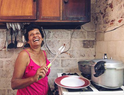Cuban woman cooking