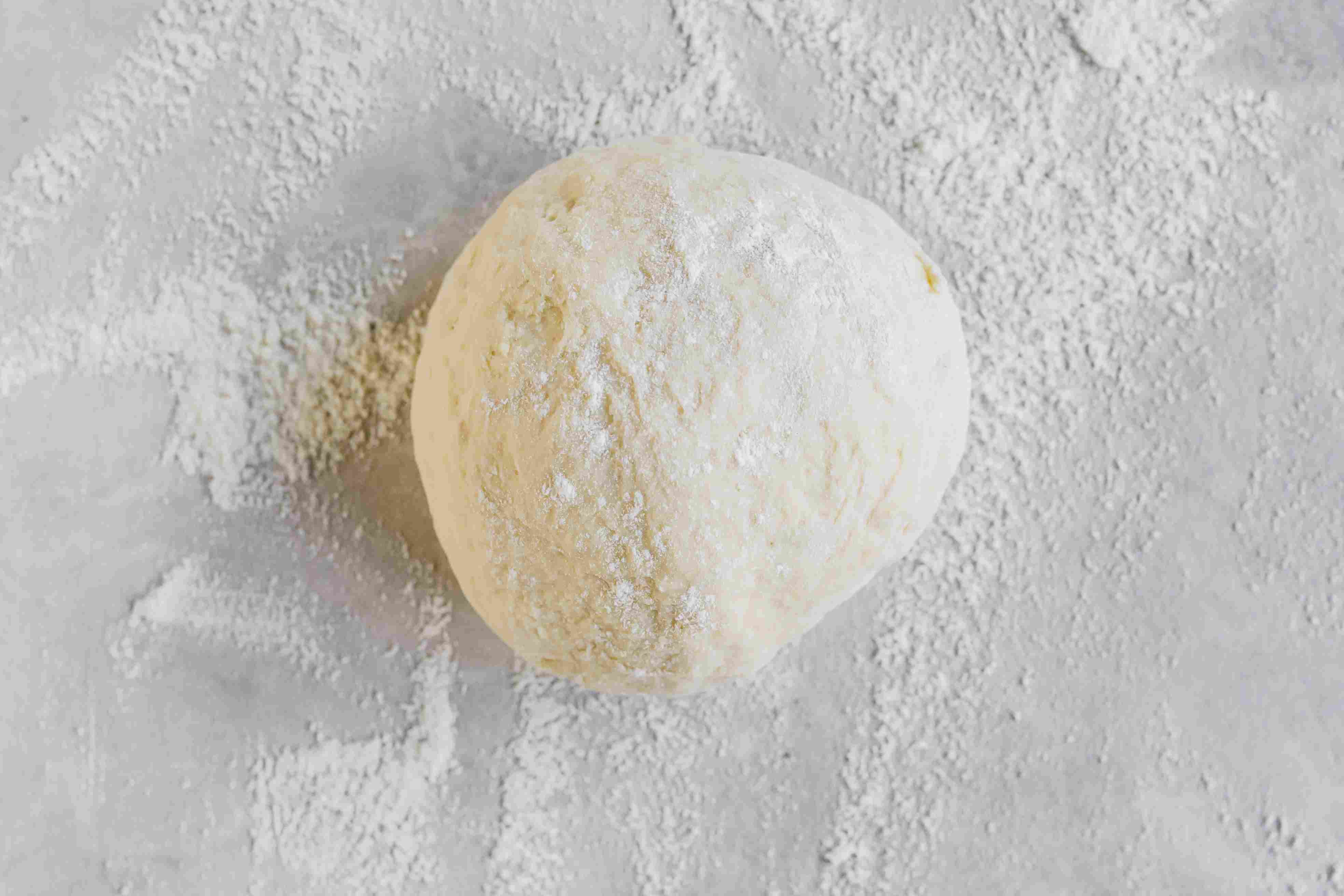 Turn the New York-style pizza dough out on a floured surface