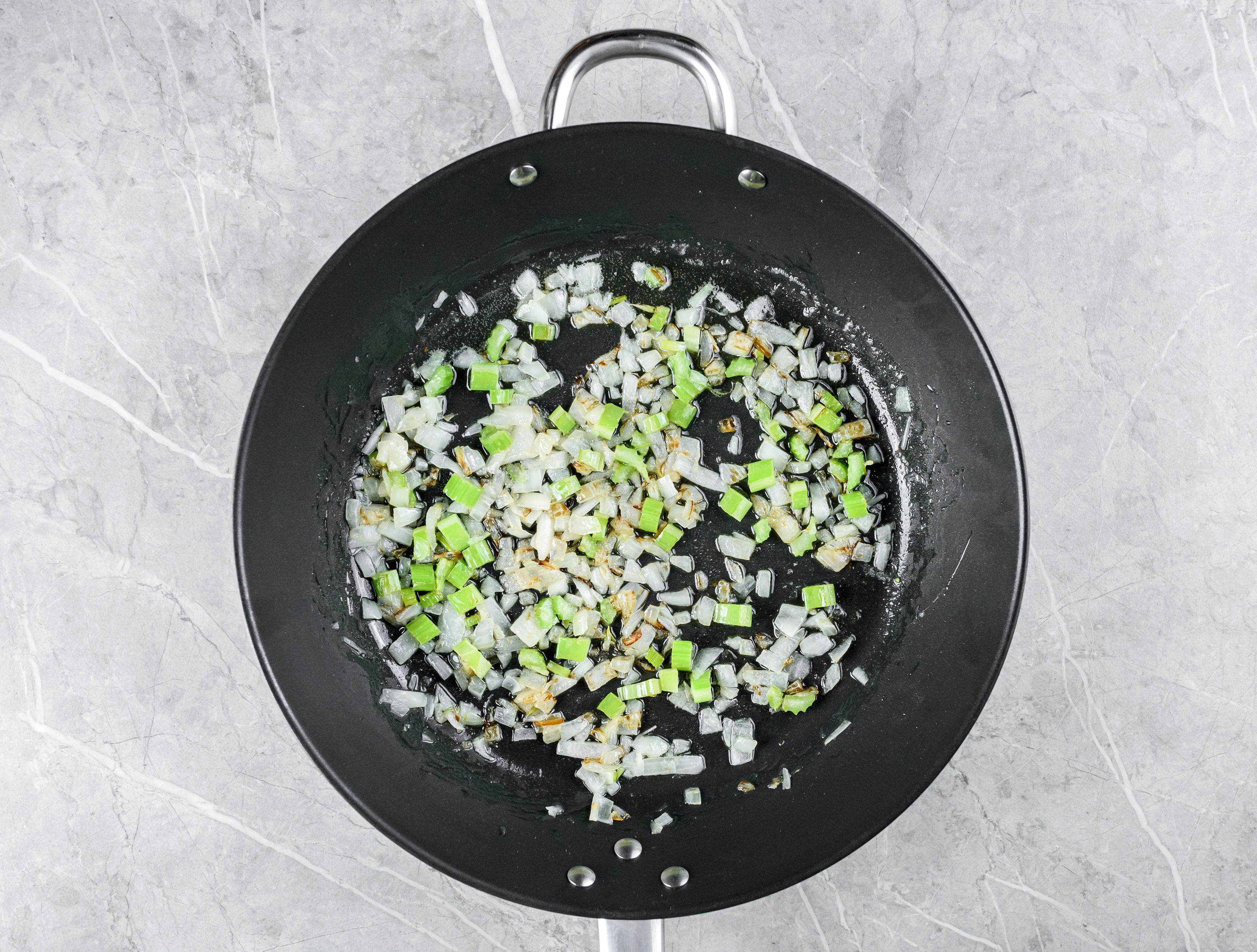 Sauté the onion and celery in the butter