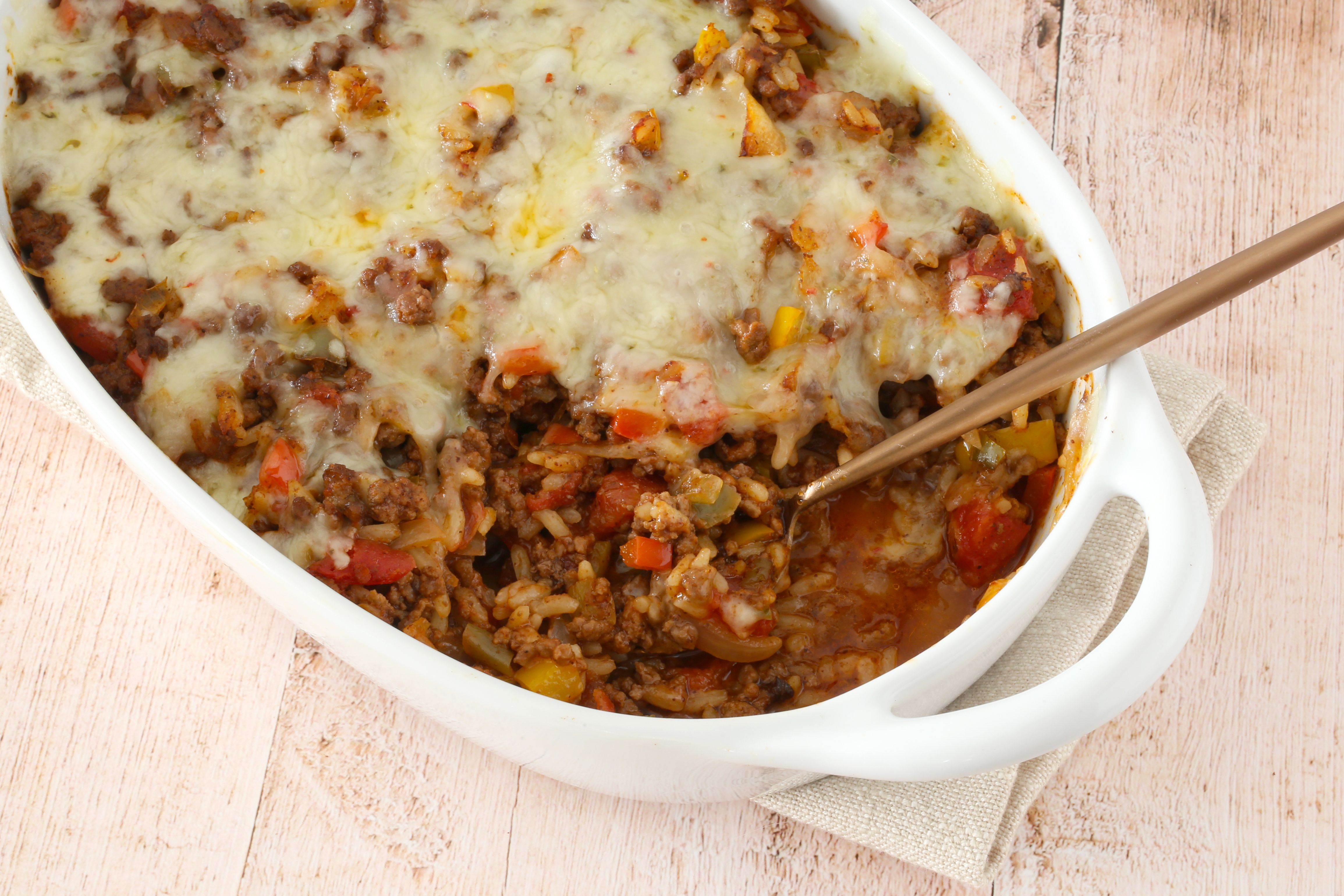 Ground beef and rice casserole with cheese topping.