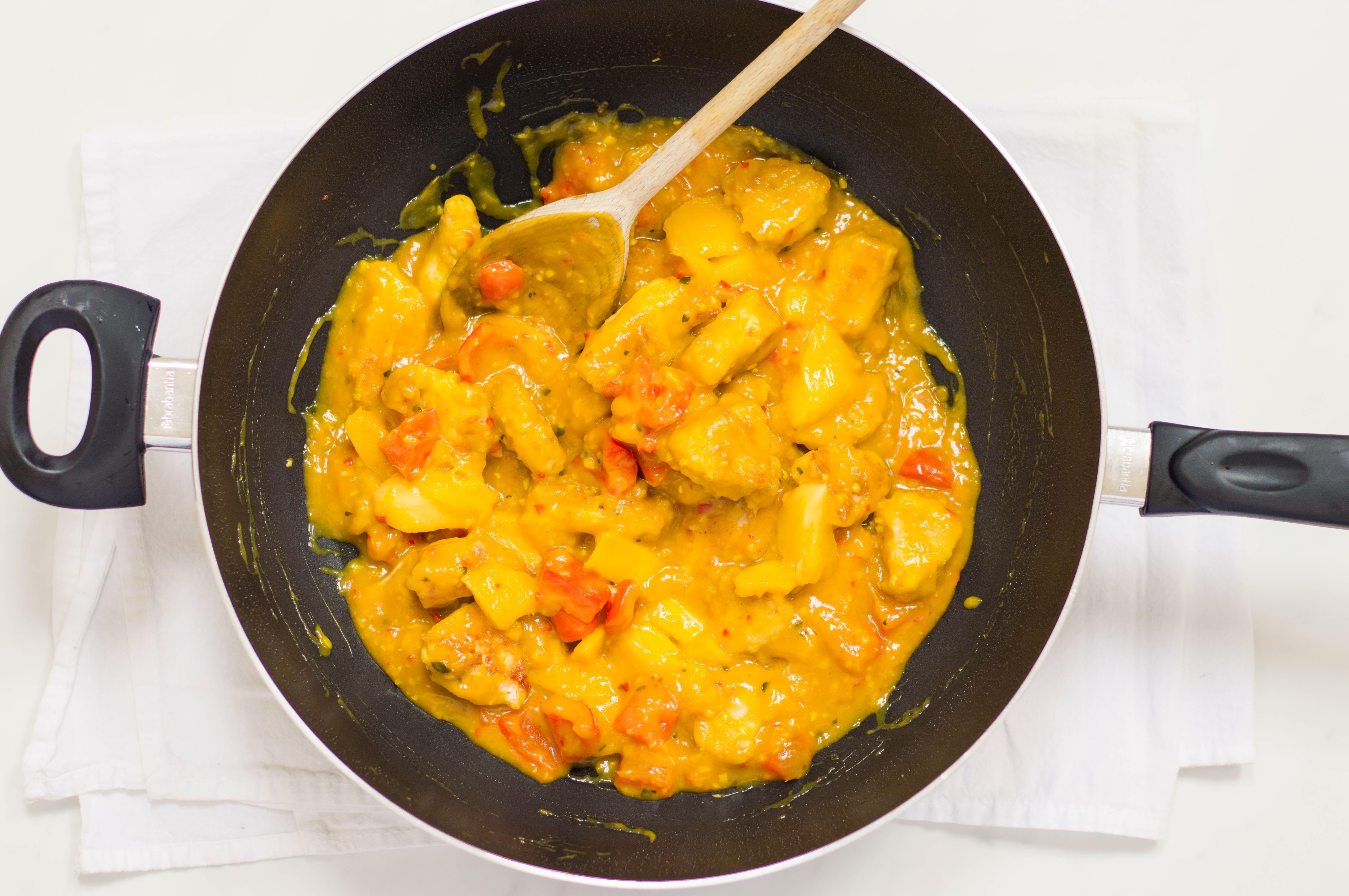 Thai mango chicken in a wok ready to taste test