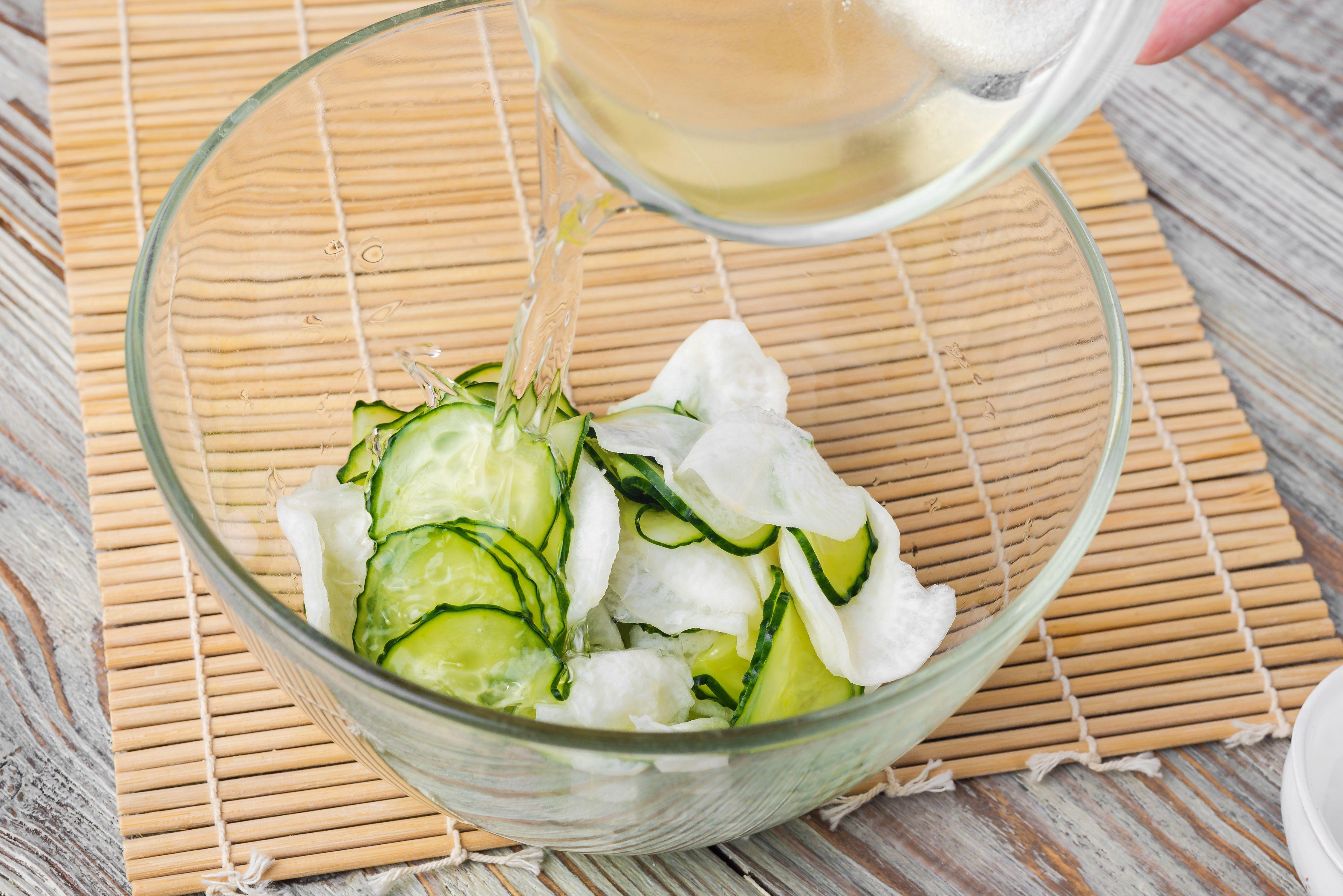 Pour vinegar over cucumber