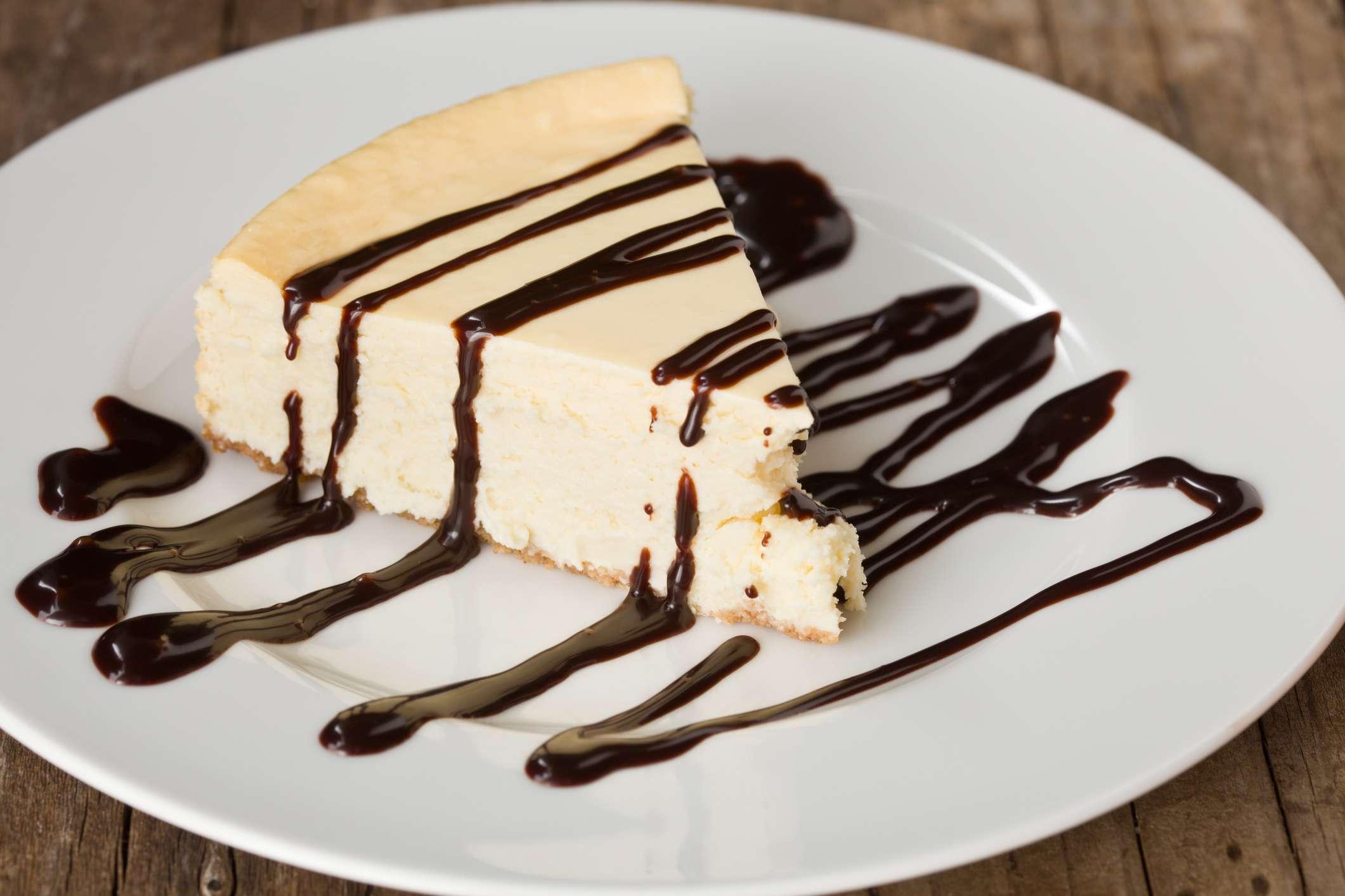 Slice Of cheesecake with chocolate ganache