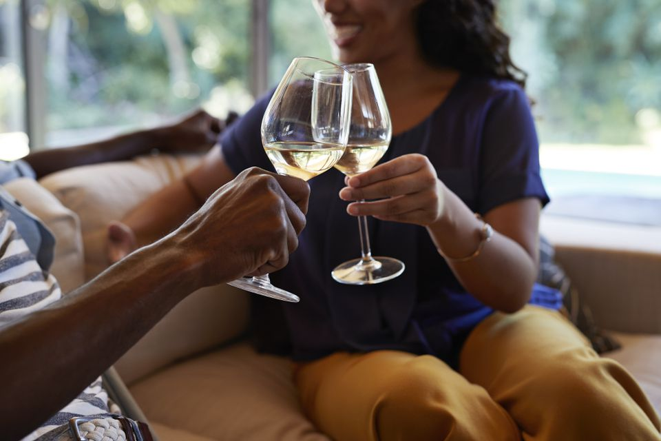 Couple toasting in wine