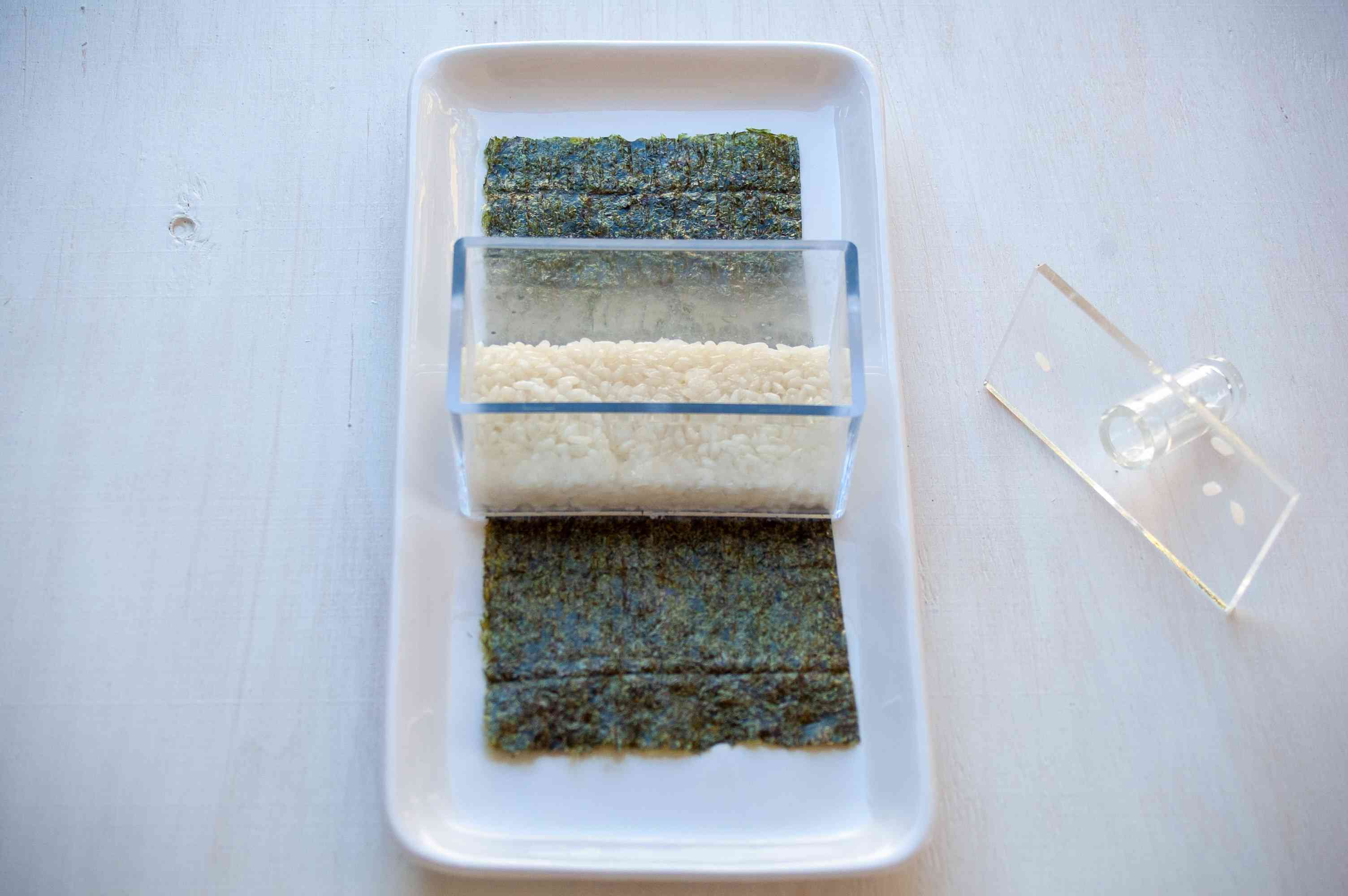 rice in a sushi mold on nori