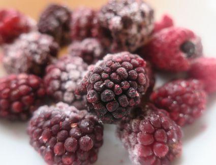 Frozen blackberries on table