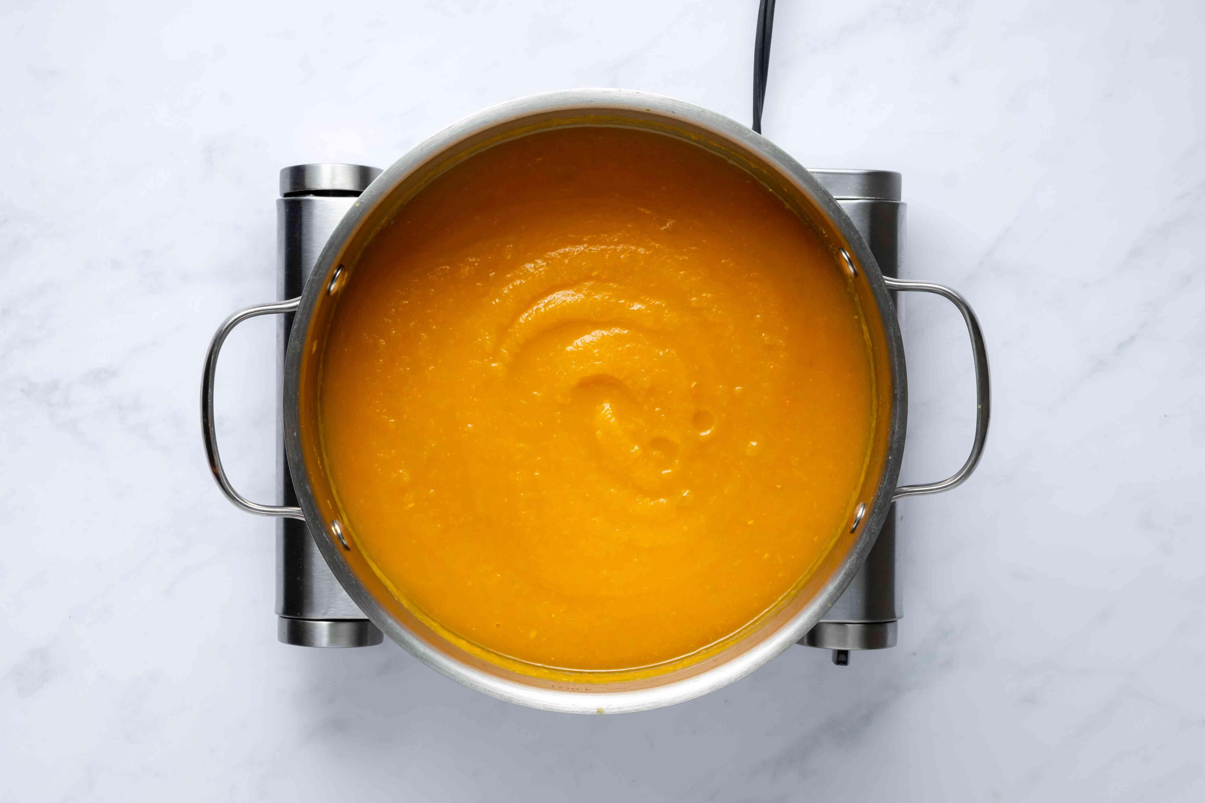 blended butternut squash soup in a pot