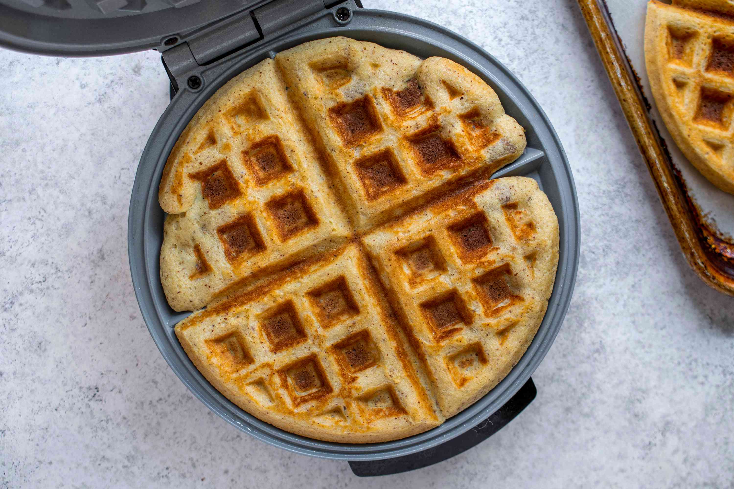 cooked waffle in a waffle iron